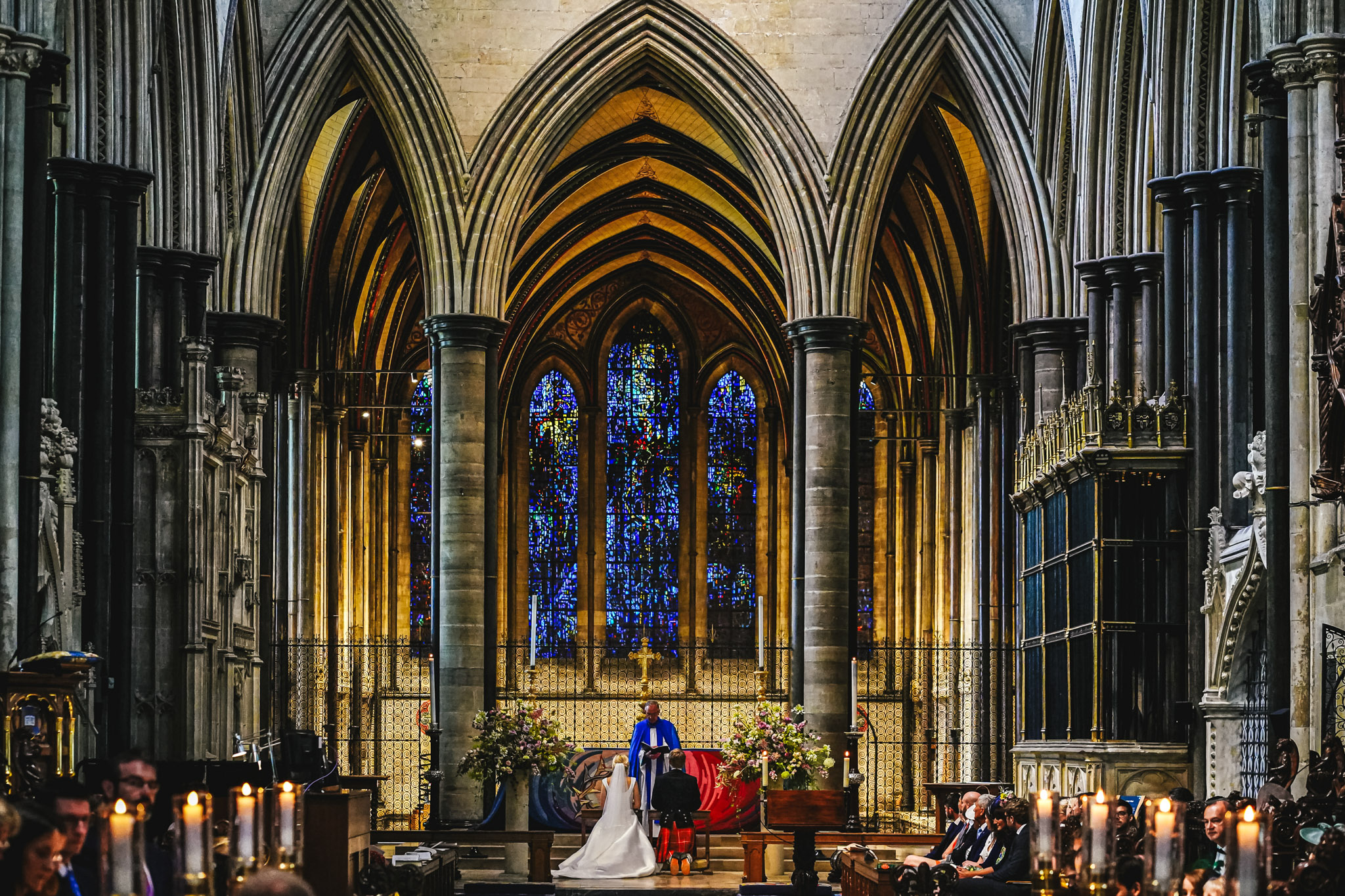 Ceremony in gothic cathedral with stained glass - photo by Andrew Billington Photography