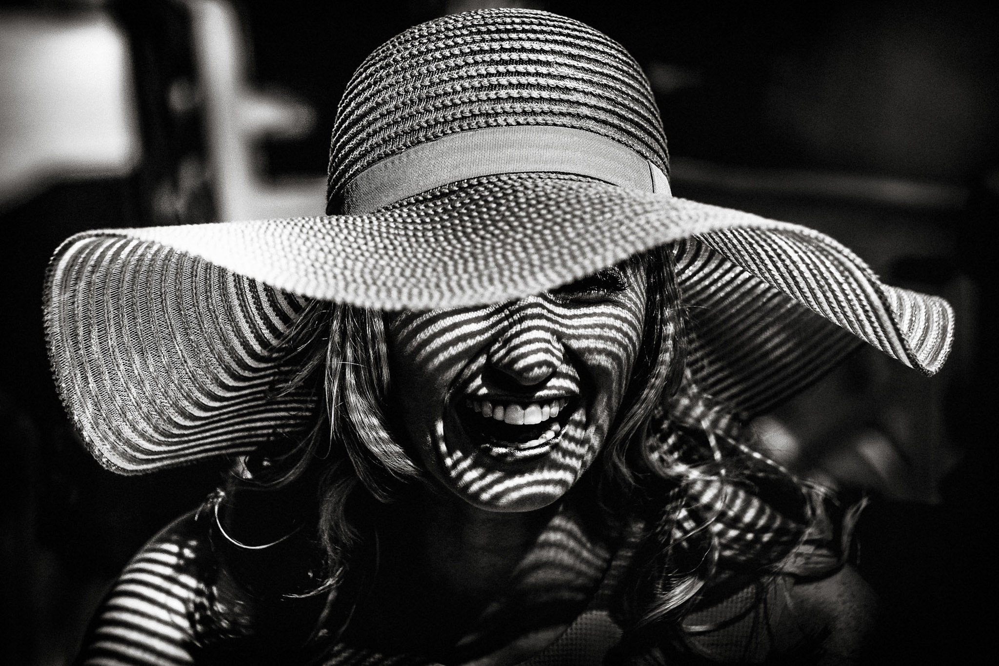 Creative black and white of a guest in a floppy hat - photo by Andrew Billington Photography