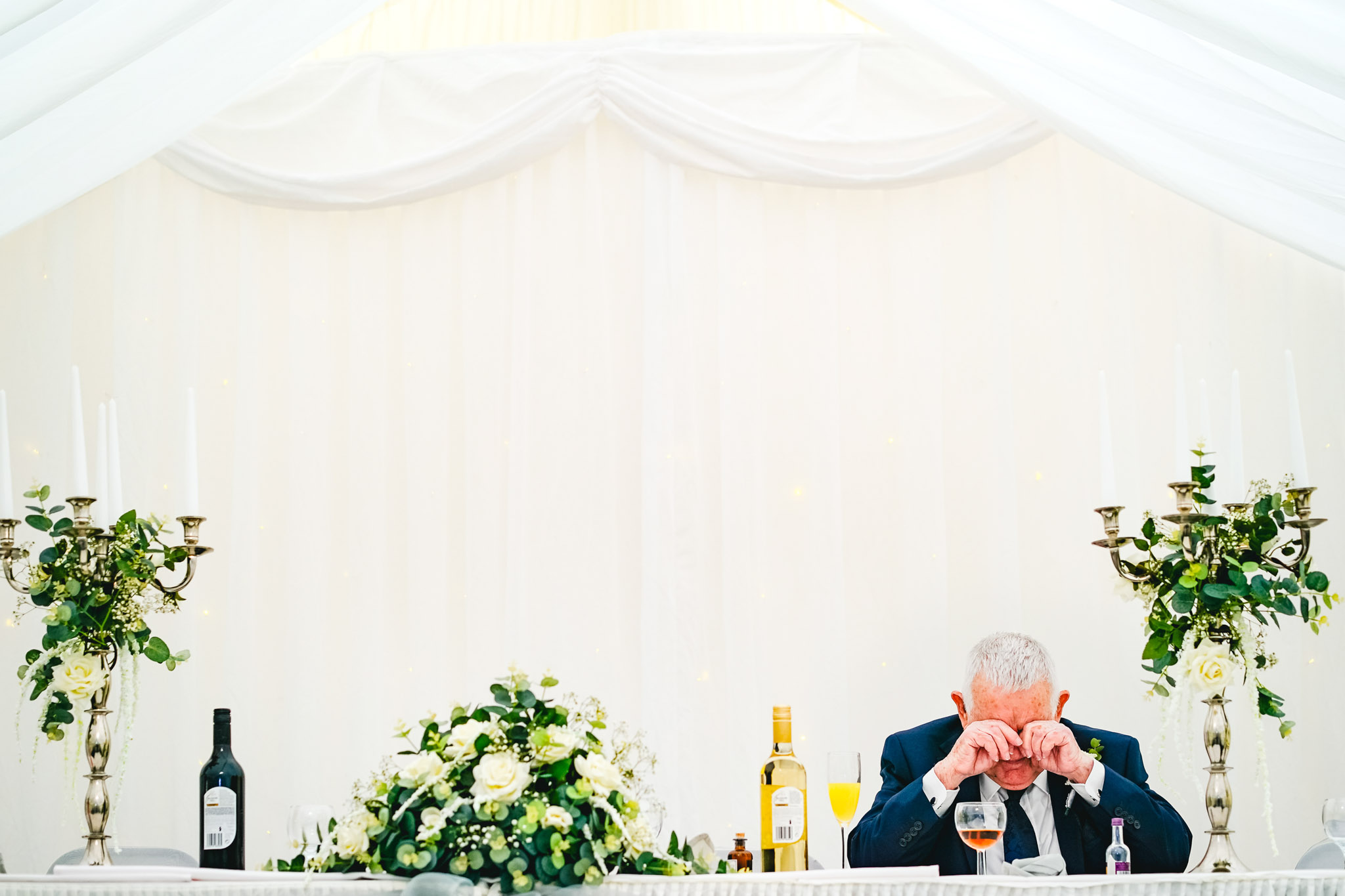 Dad dries at wedding reception table- photo by Andrew Billington Photography