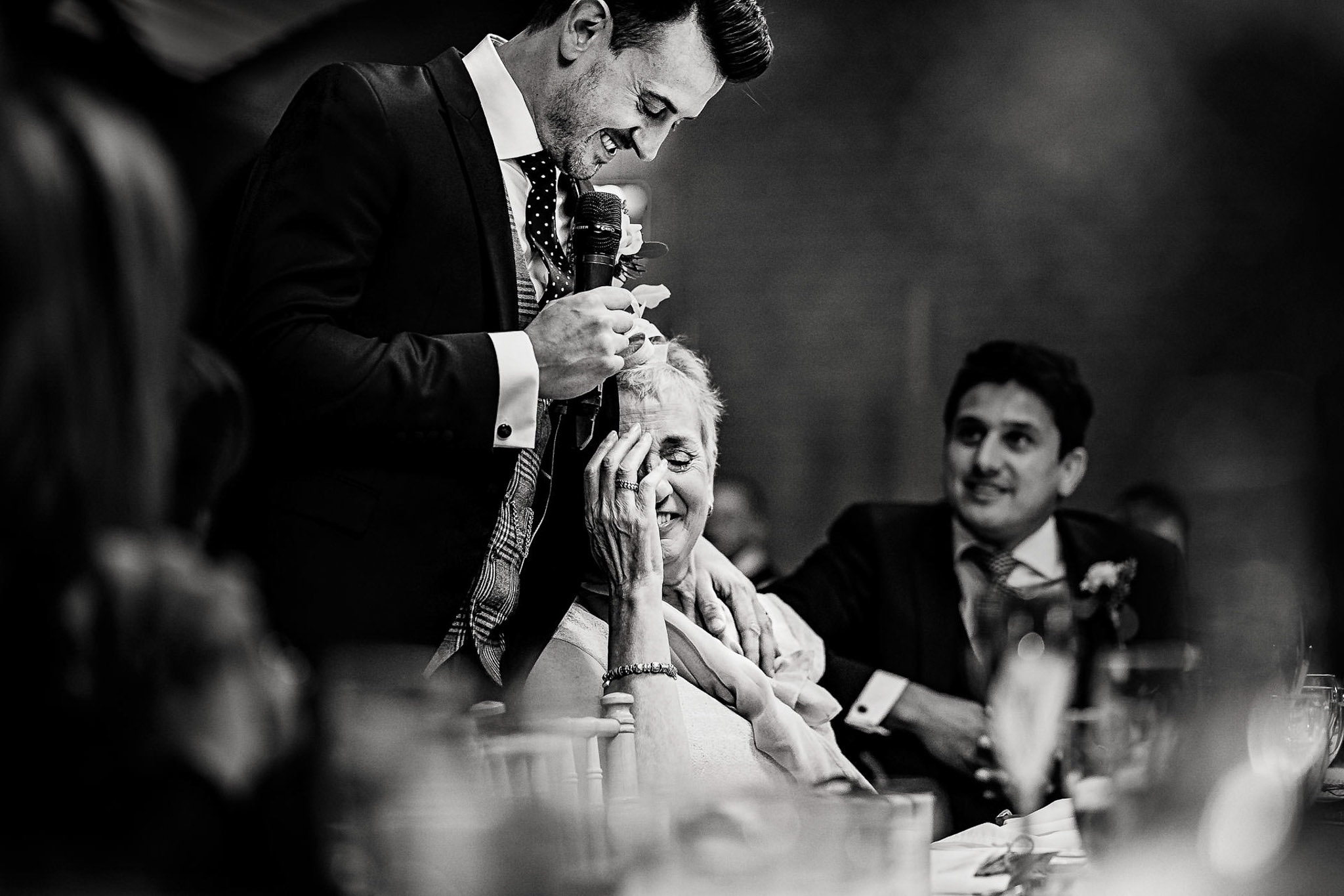 Groom and mom share a moment - photo by Andrew Billington Photography
