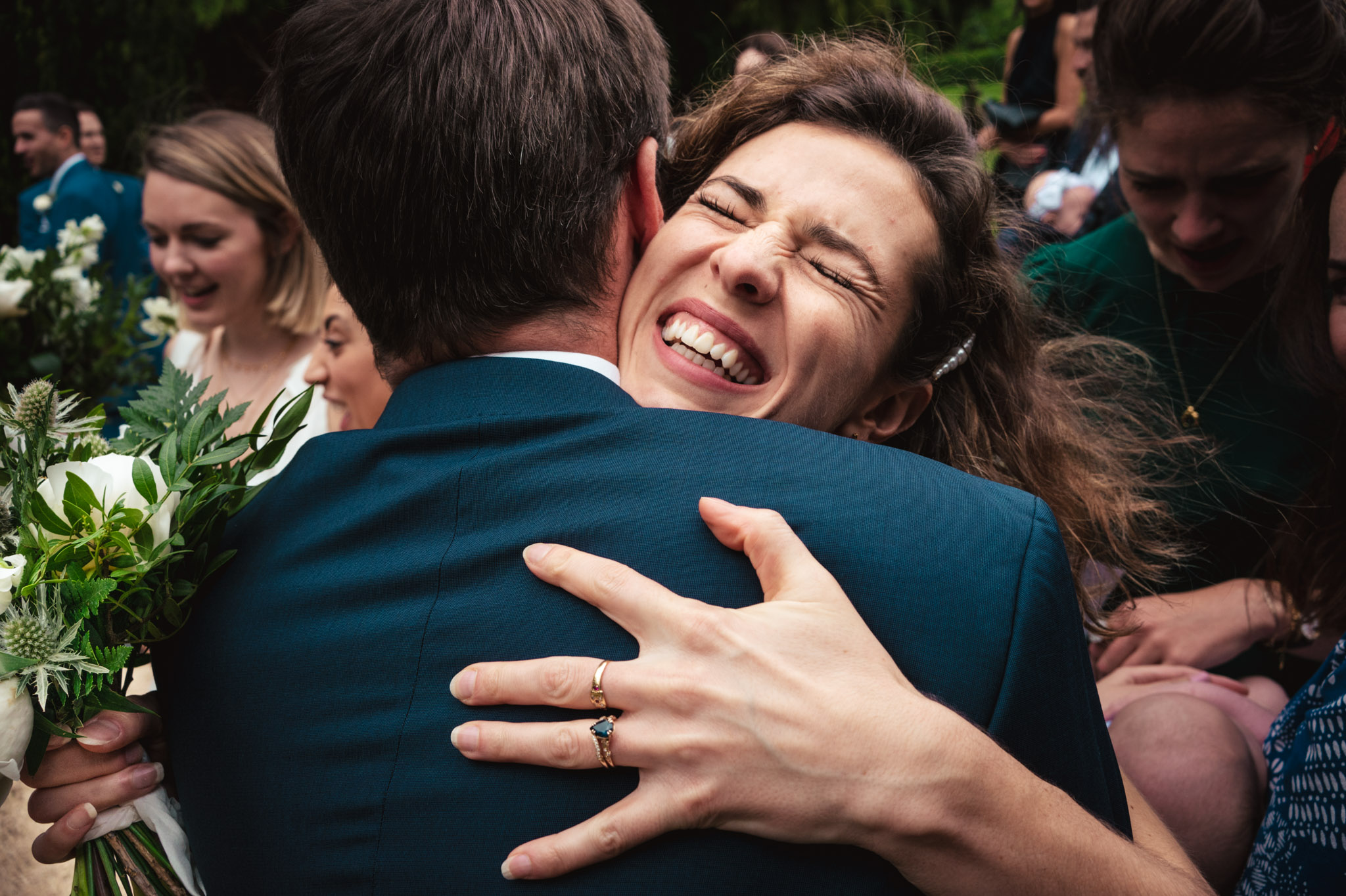 Big embrace for the groom - photo by Andrew Billington Photography