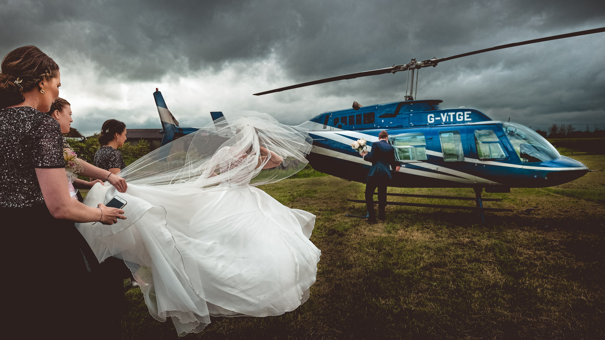Bride and groom boarding chopper - photo by Andrew Billington Photography