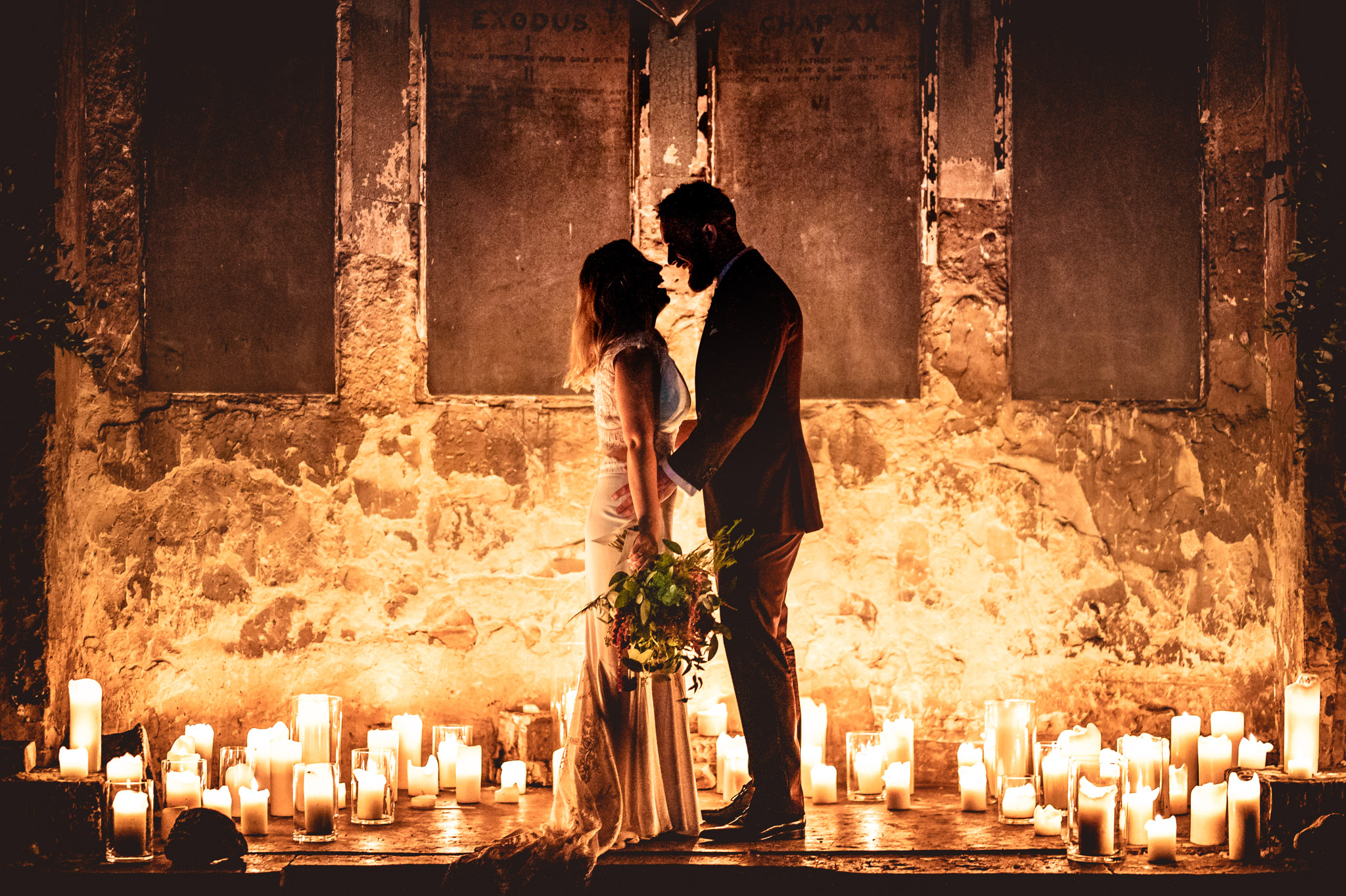 Bride and groom silhouette against candlelight - photo by Andrew Billington Photography