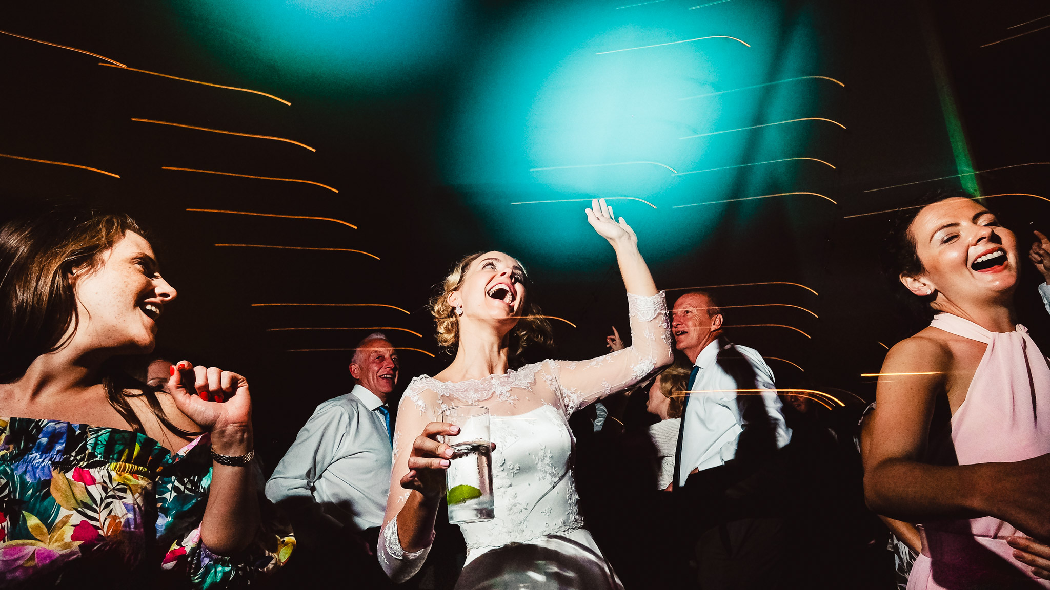 Bride and guests dancing - photo by Andrew Billington Photography