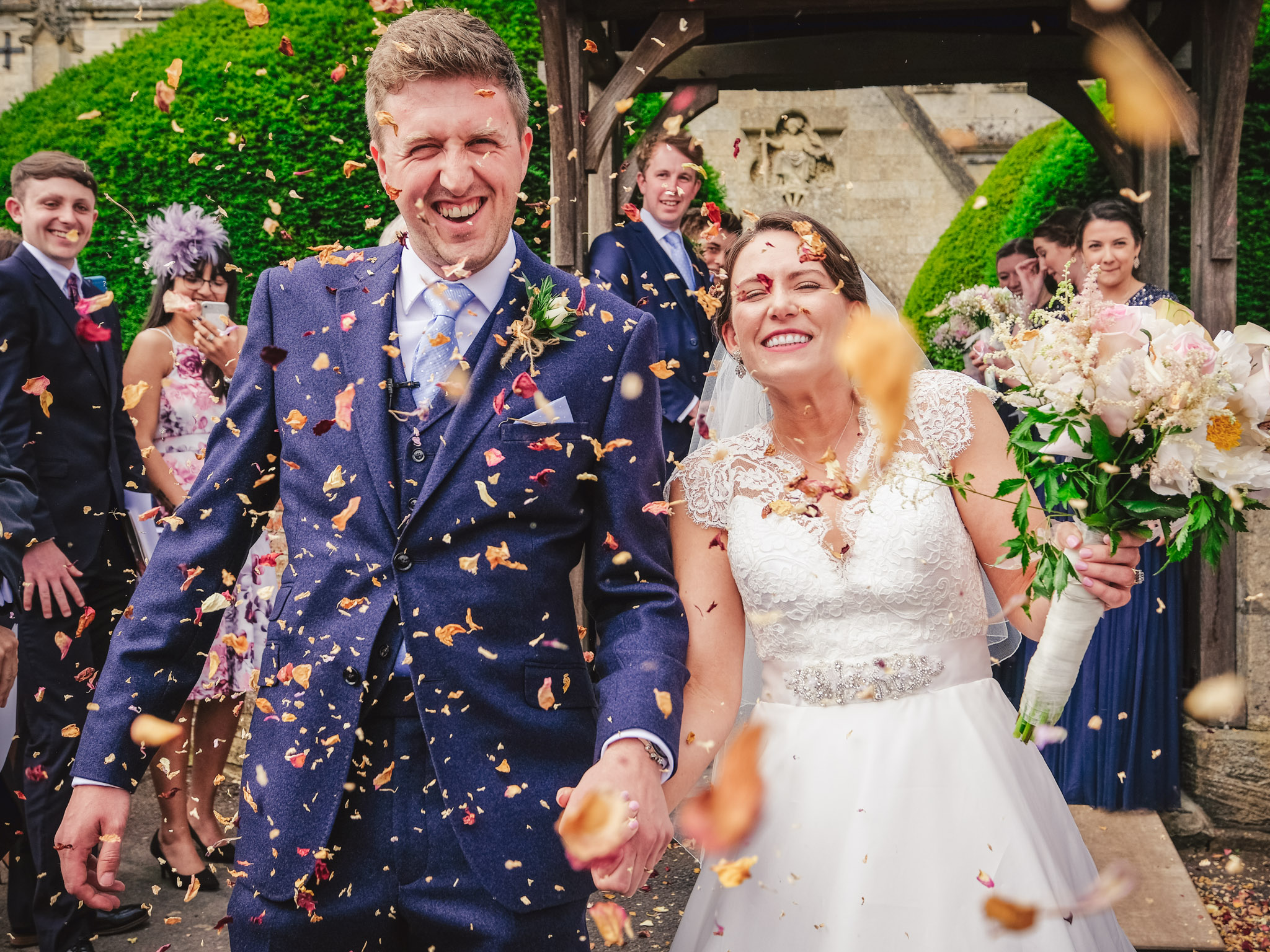 Couple recessional through confetti - photo by Andrew Billington Photography
