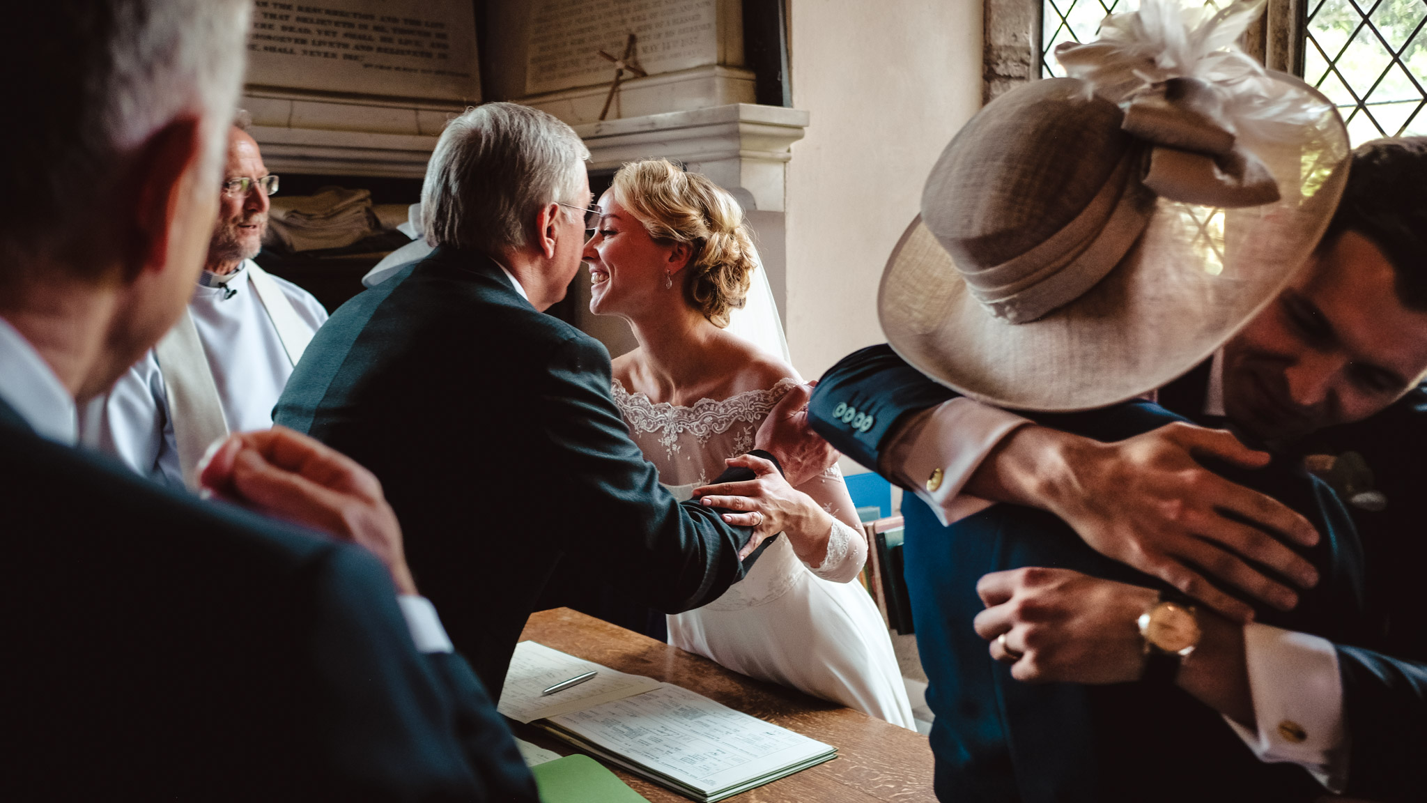 Hugs at signing of marriage documents - photo by Andrew Billington Photography
