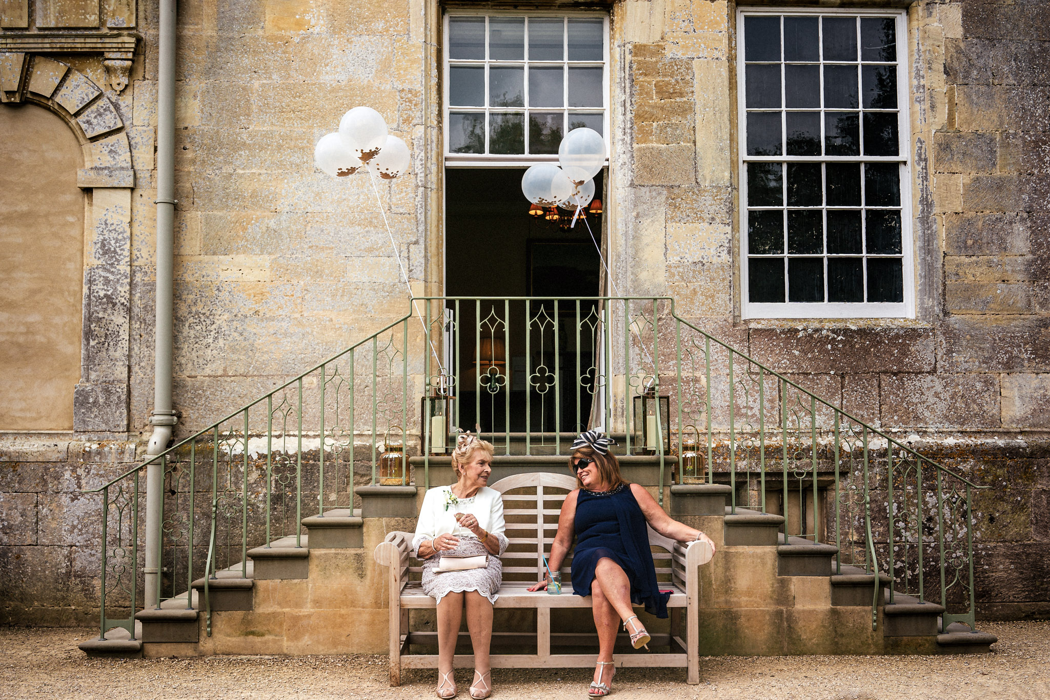 Ladies chatting on bench - photo by Andrew Billington Photography