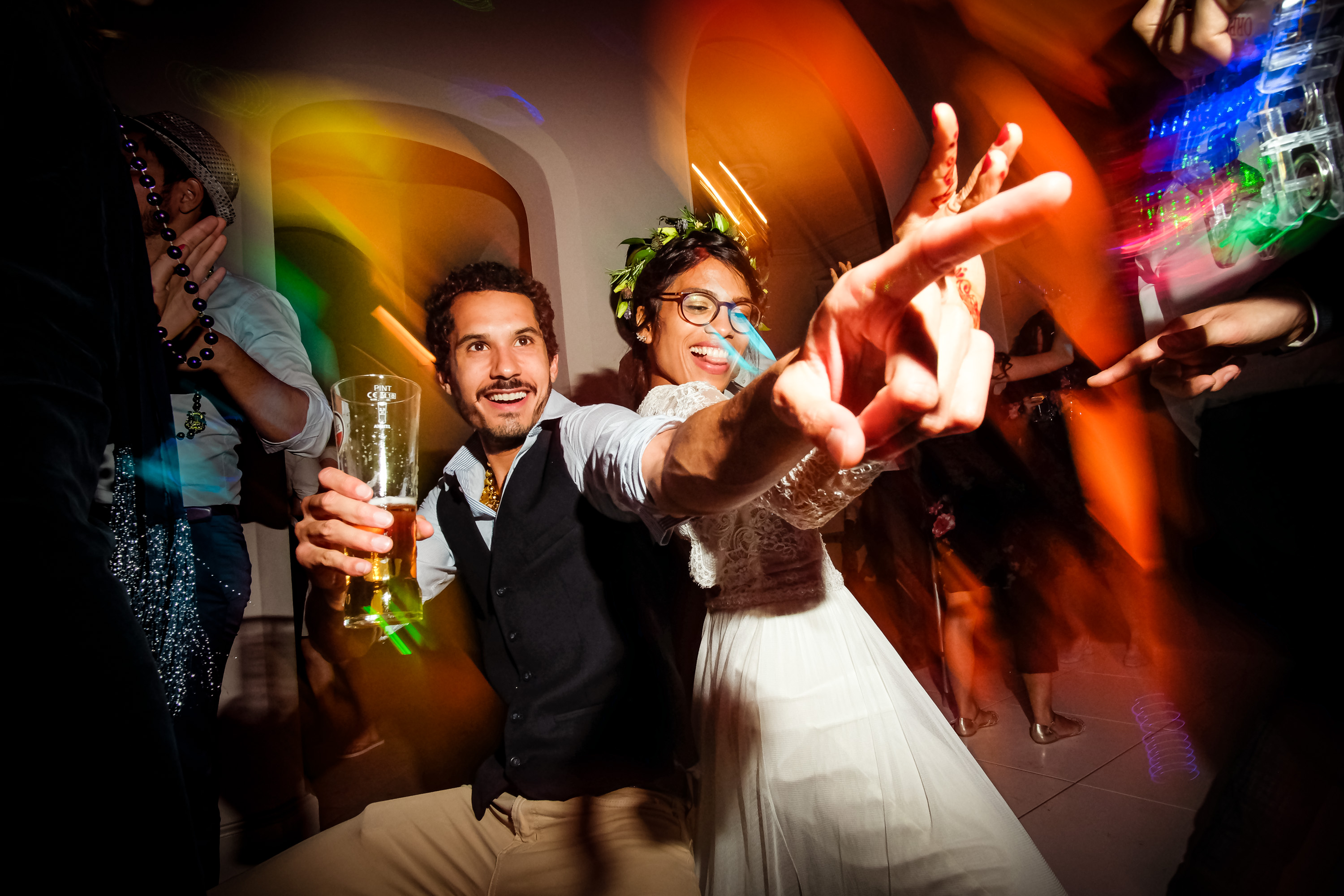 Colorful photo of couple dancing at wedding reception by Andrew Billington - UK wedding photographer