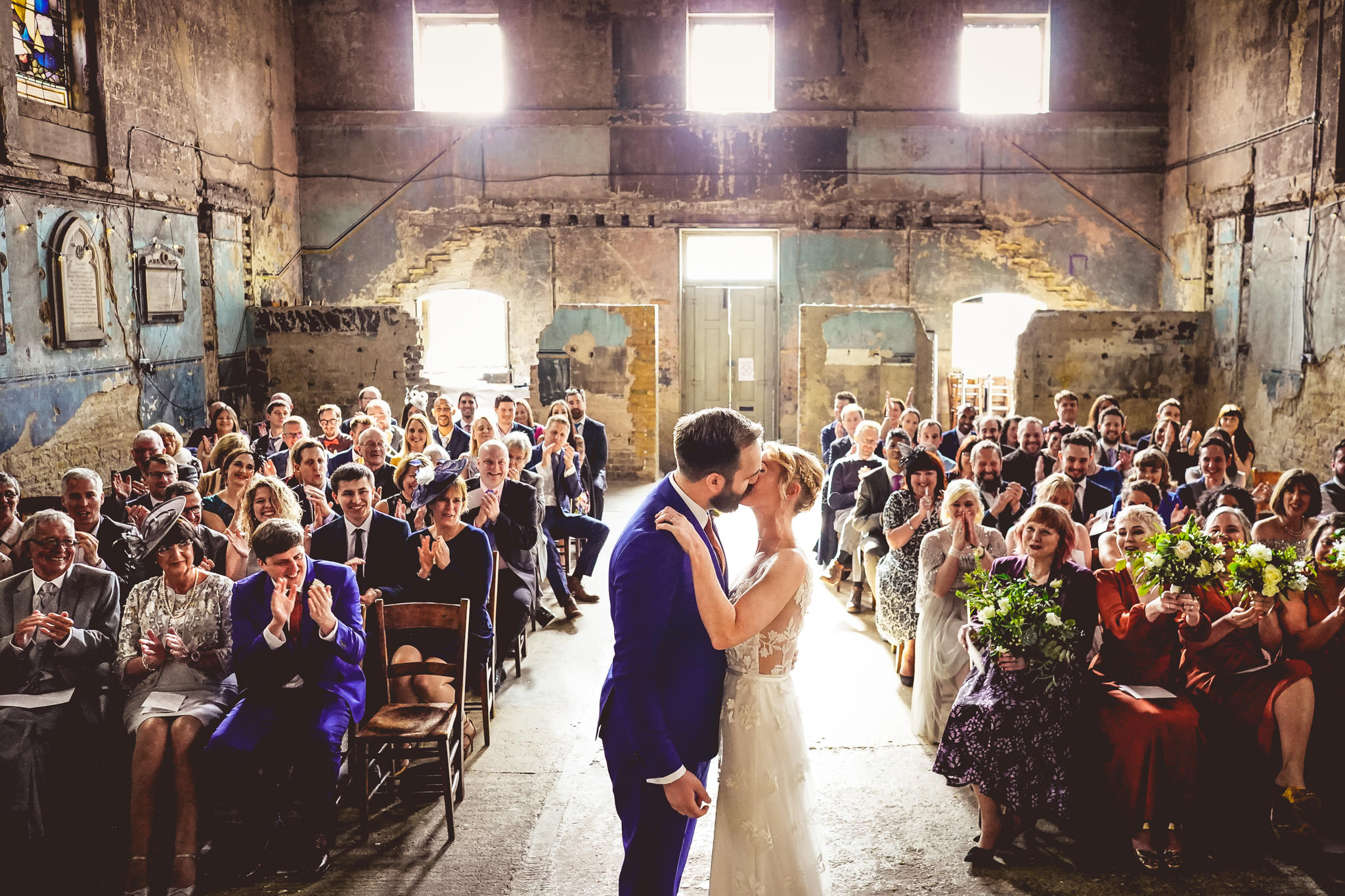 Ceremonial kiss inside Asylum Chapel - photo by Andrew Billington Photography