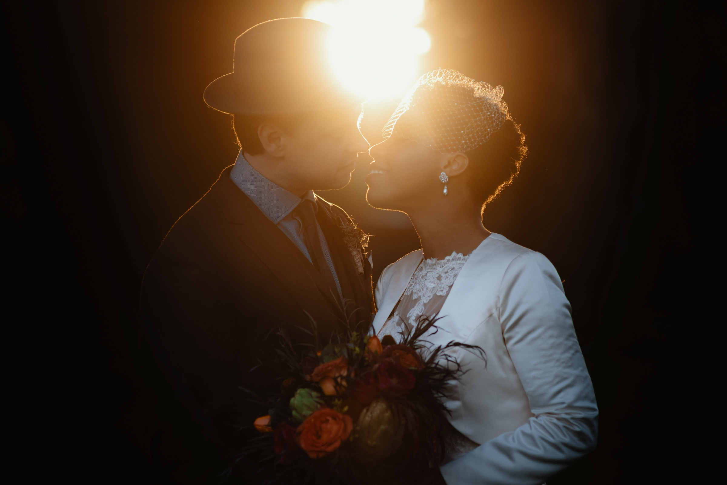 bride and groom almost kiss portrait among pretty backlight- photo by Dark Roux