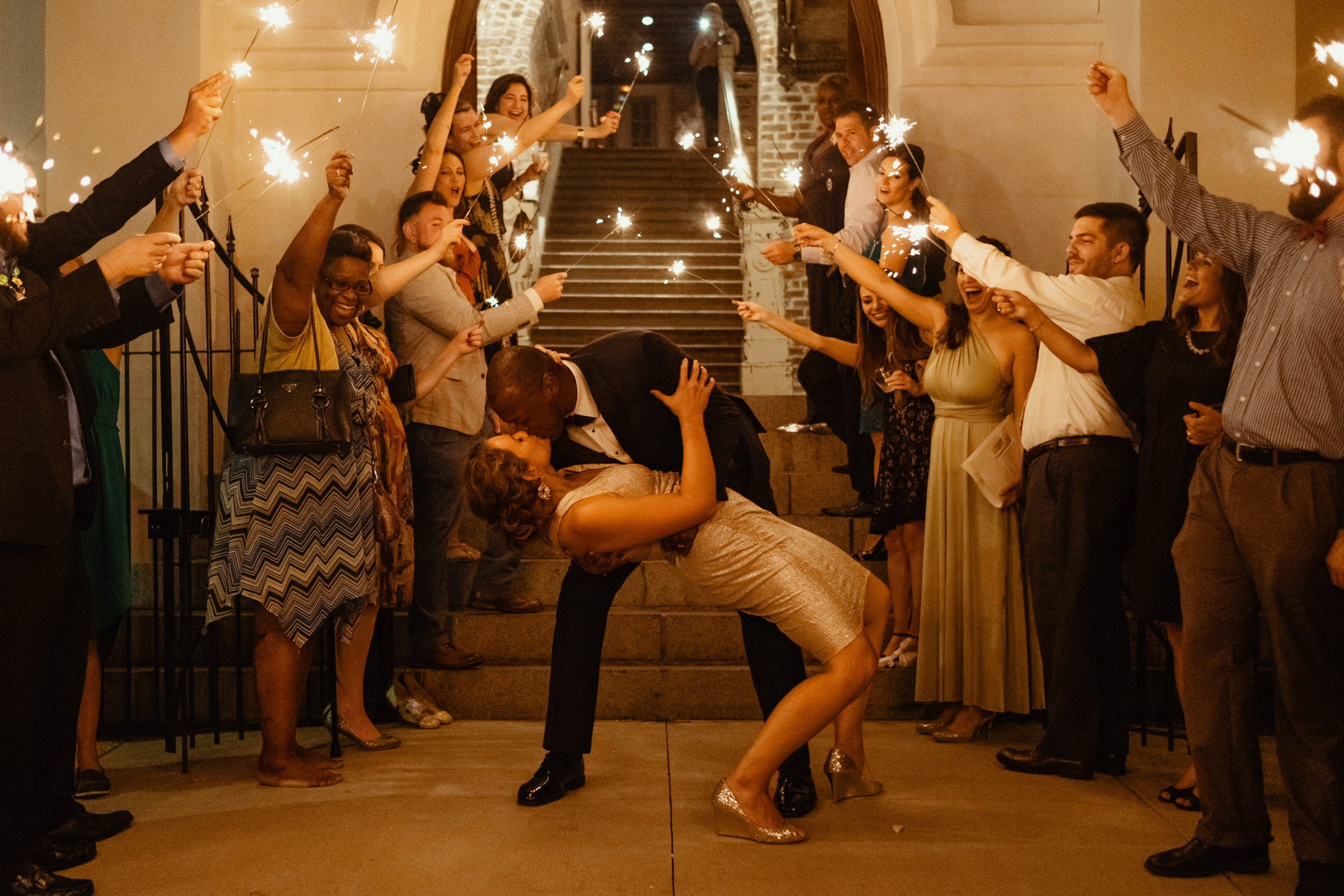bride and groom exiting reception under sparklers-new orleans-austin-houston-wedding photographer- photo by Dark Roux