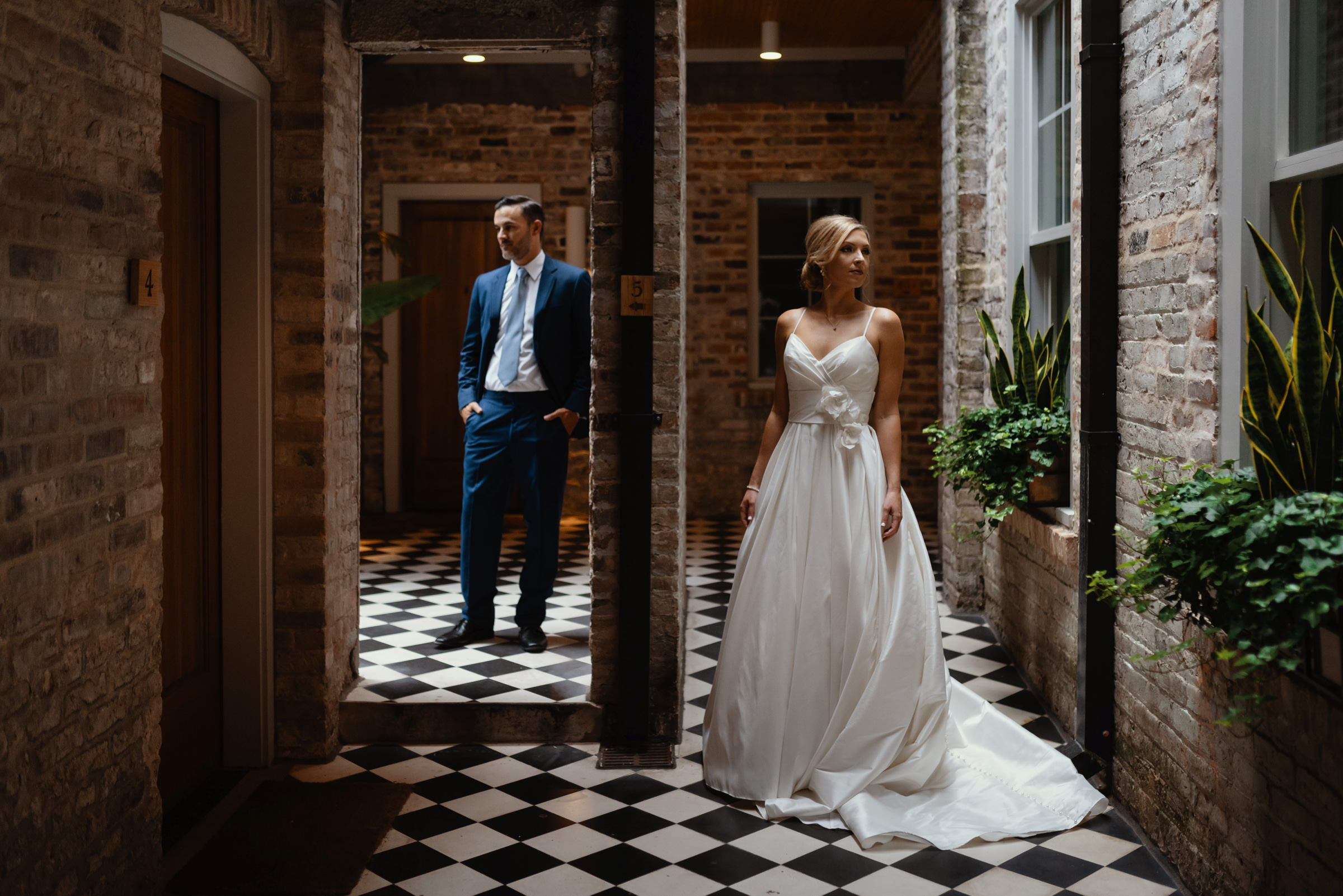 bride and groom formal portrait in the doorways-new orleans-austin-houston-wedding photographer- photo by Dark Roux