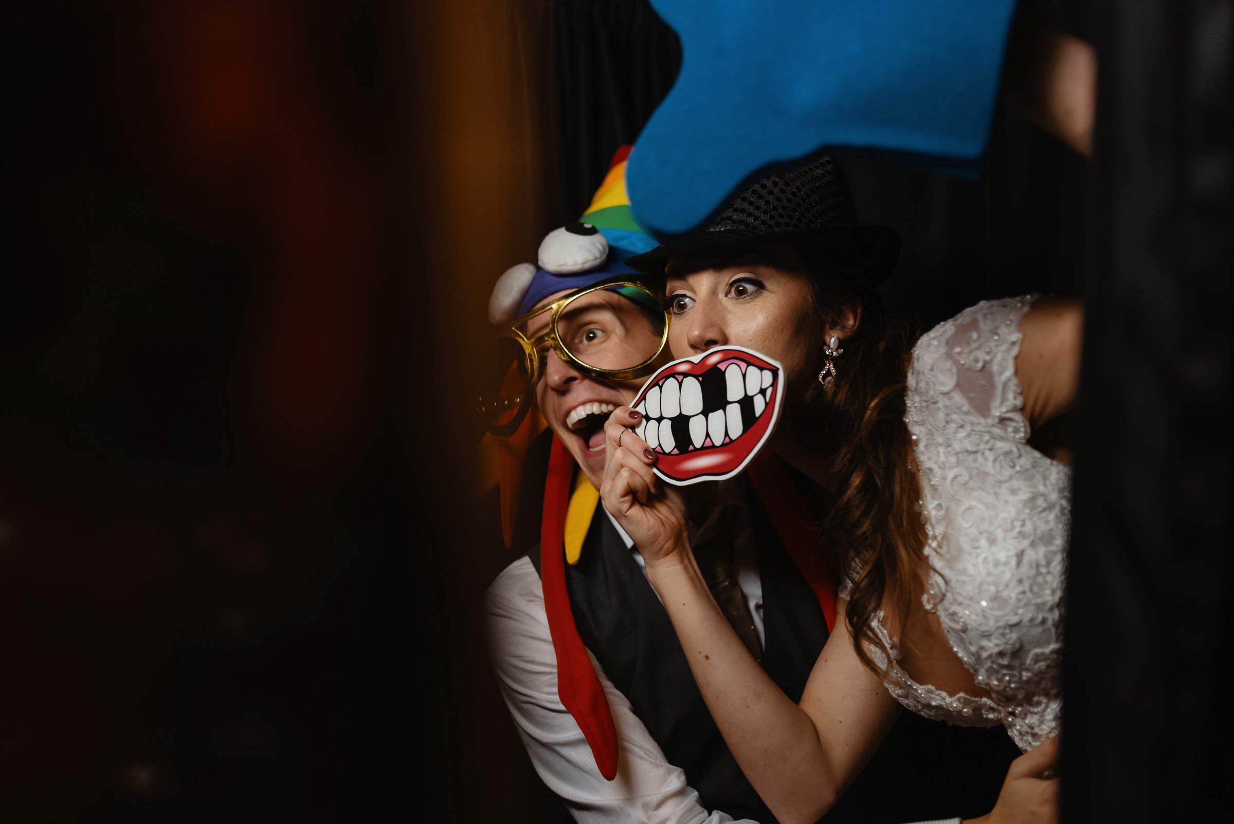 bride and groom having fun in the photobooth-new orleans-austin-houston- photo by Dark Roux