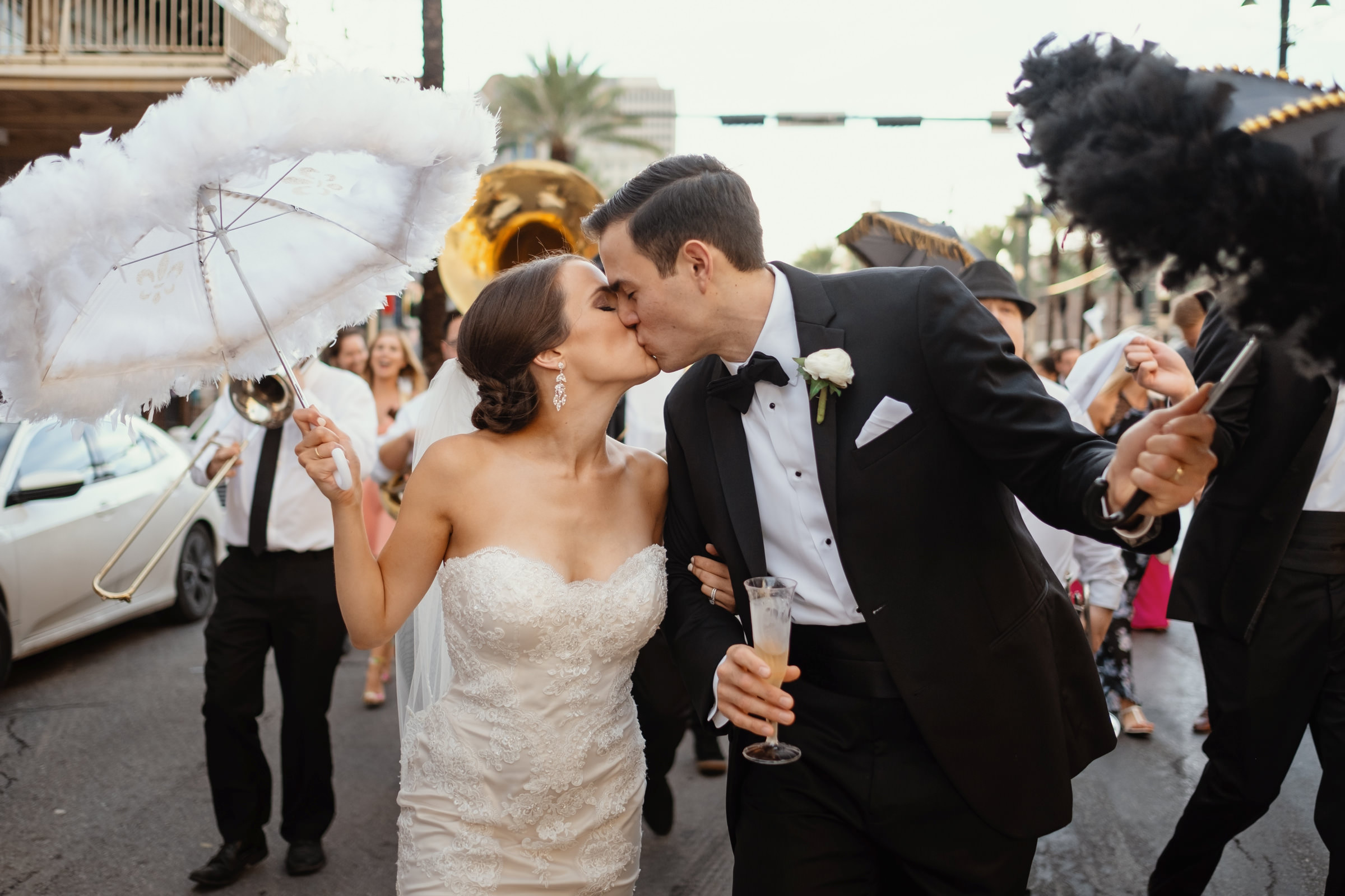 bride and groom  in a wedding parade having a sweet kiss-new orleans-austin-houston-wedding photographer- photo by Dark Roux