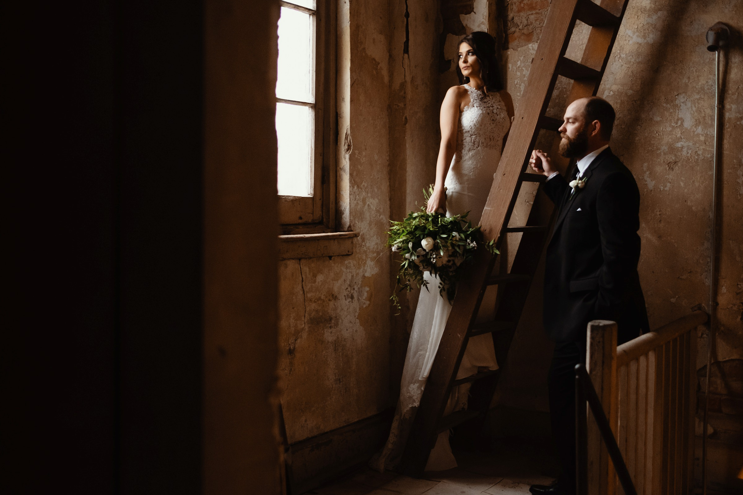 bride and groom portrait in a cozy loft-new orleans-austin-houston- photo by Dark Roux