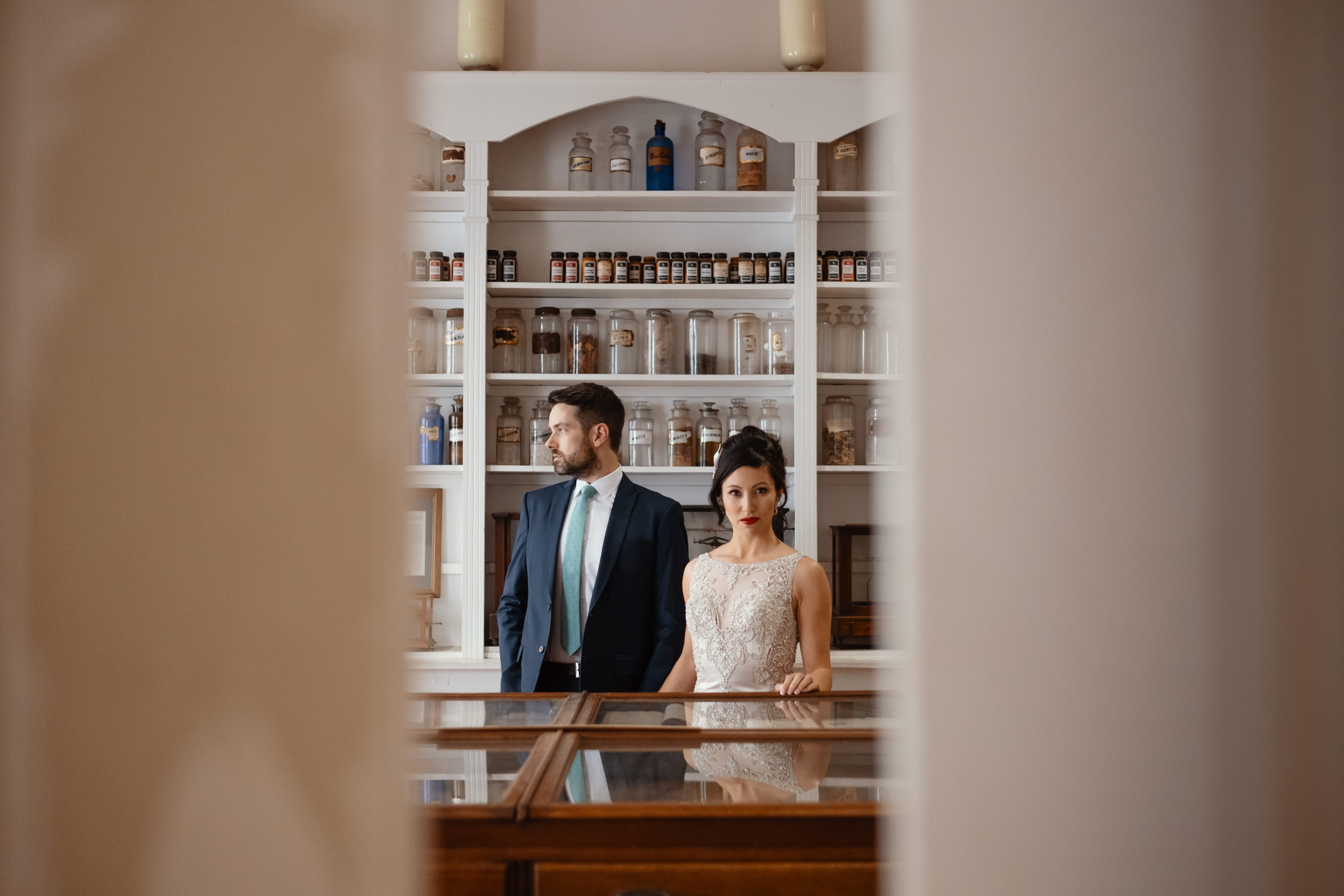 bride and groom portrait in the candy shop-new orleans-austin-houston-wedding photographer- photo by Dark Roux