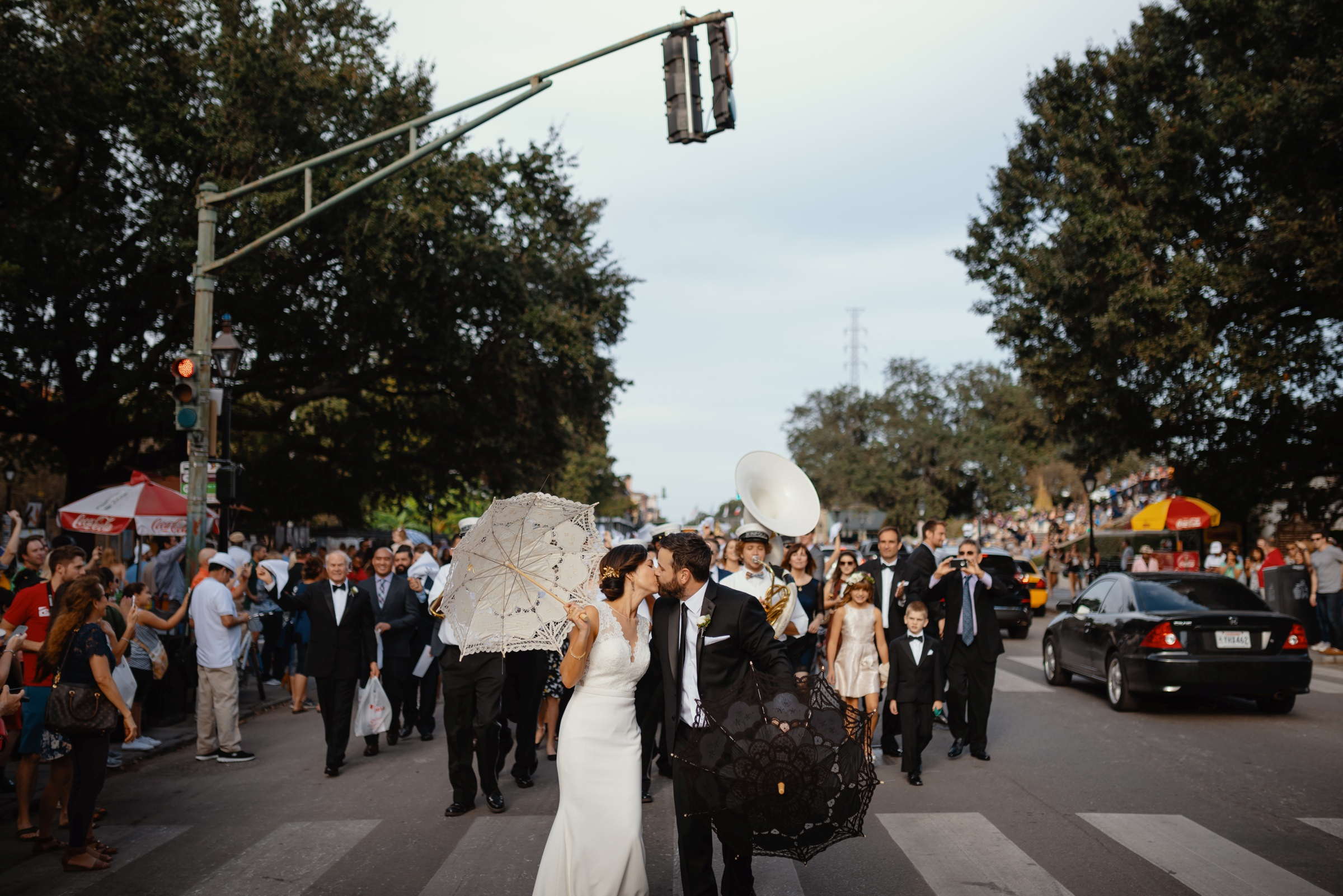 bride and groom wedding parade among the tourists in new orleans-austin-houston-wedding- photo by Dark Roux