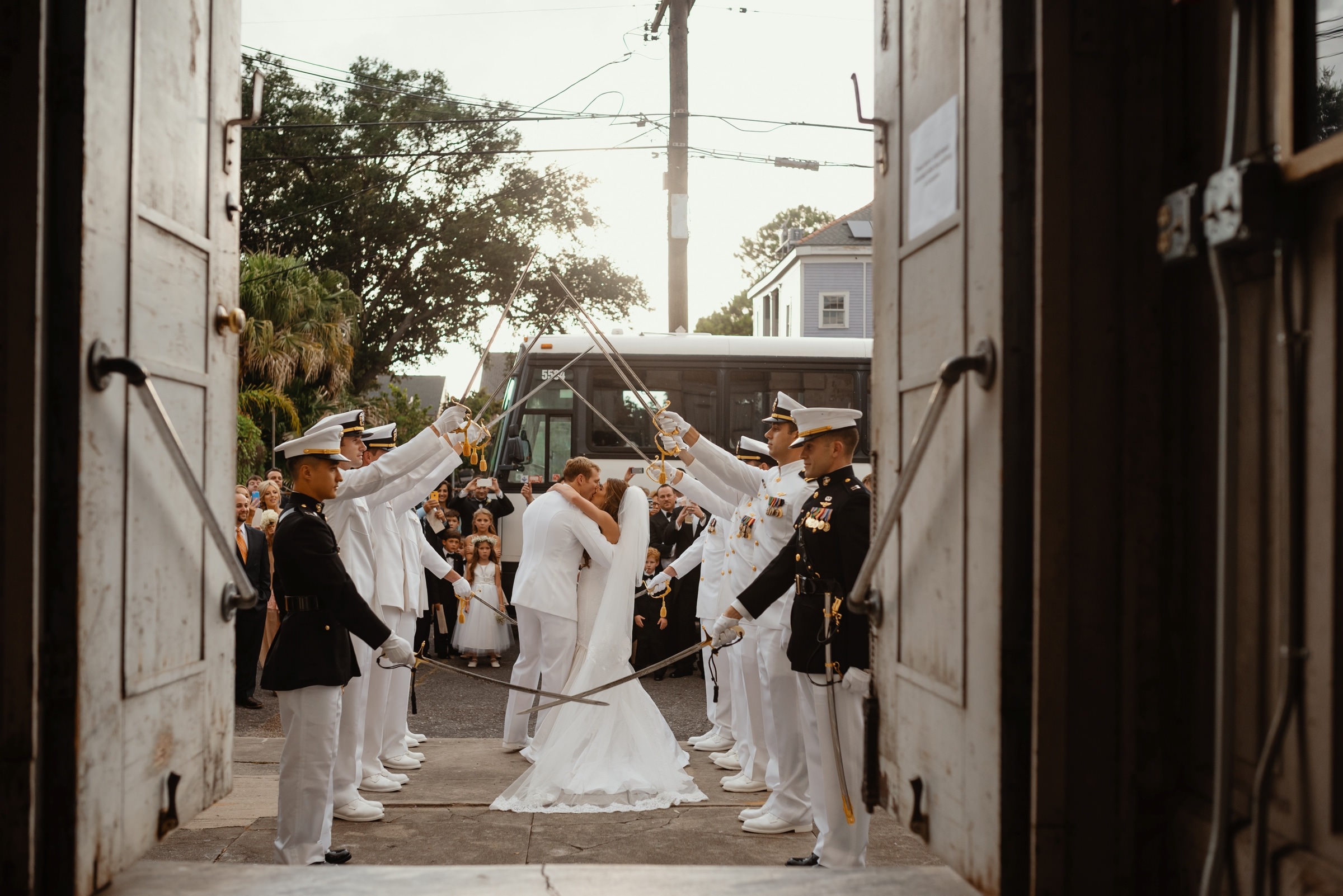 bride and military groom leaving church with a big kiss-new orleans-austin-houston-wedding- photo by Dark Roux