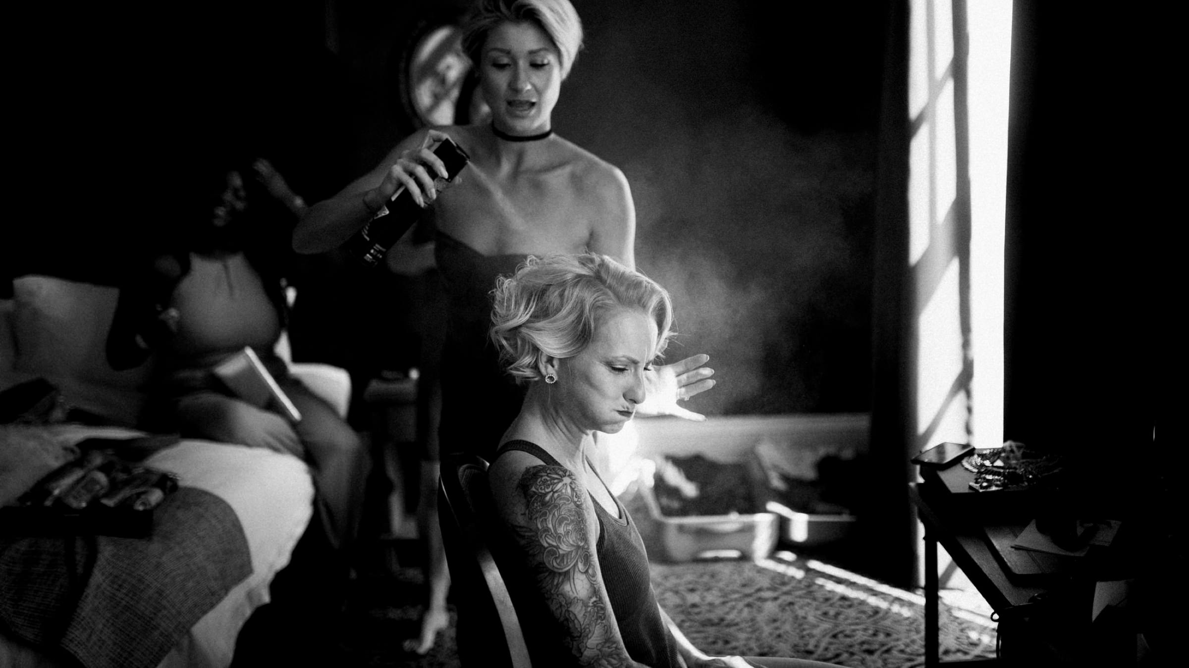 bride getting her hairspray on-new orleans-austin-houston-wedding- photo by Dark Roux