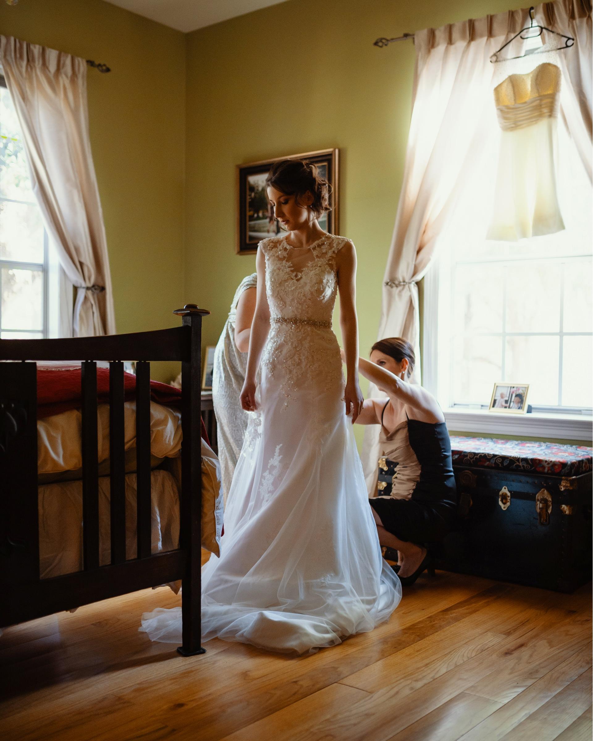 bridesmaids helping bride get dressed-new orleans-austin-houston- photo by Dark Roux