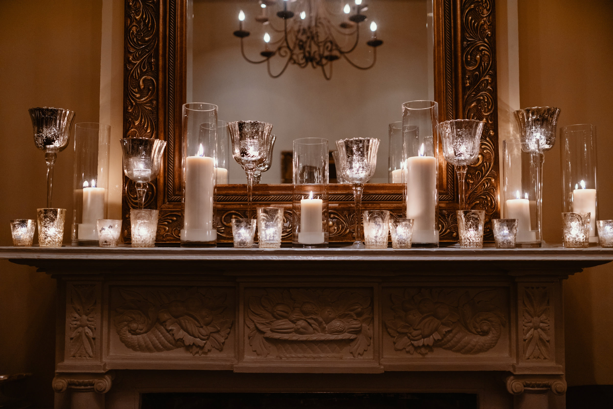 candle lit reception decor on the fireplace- photo by Dark Roux