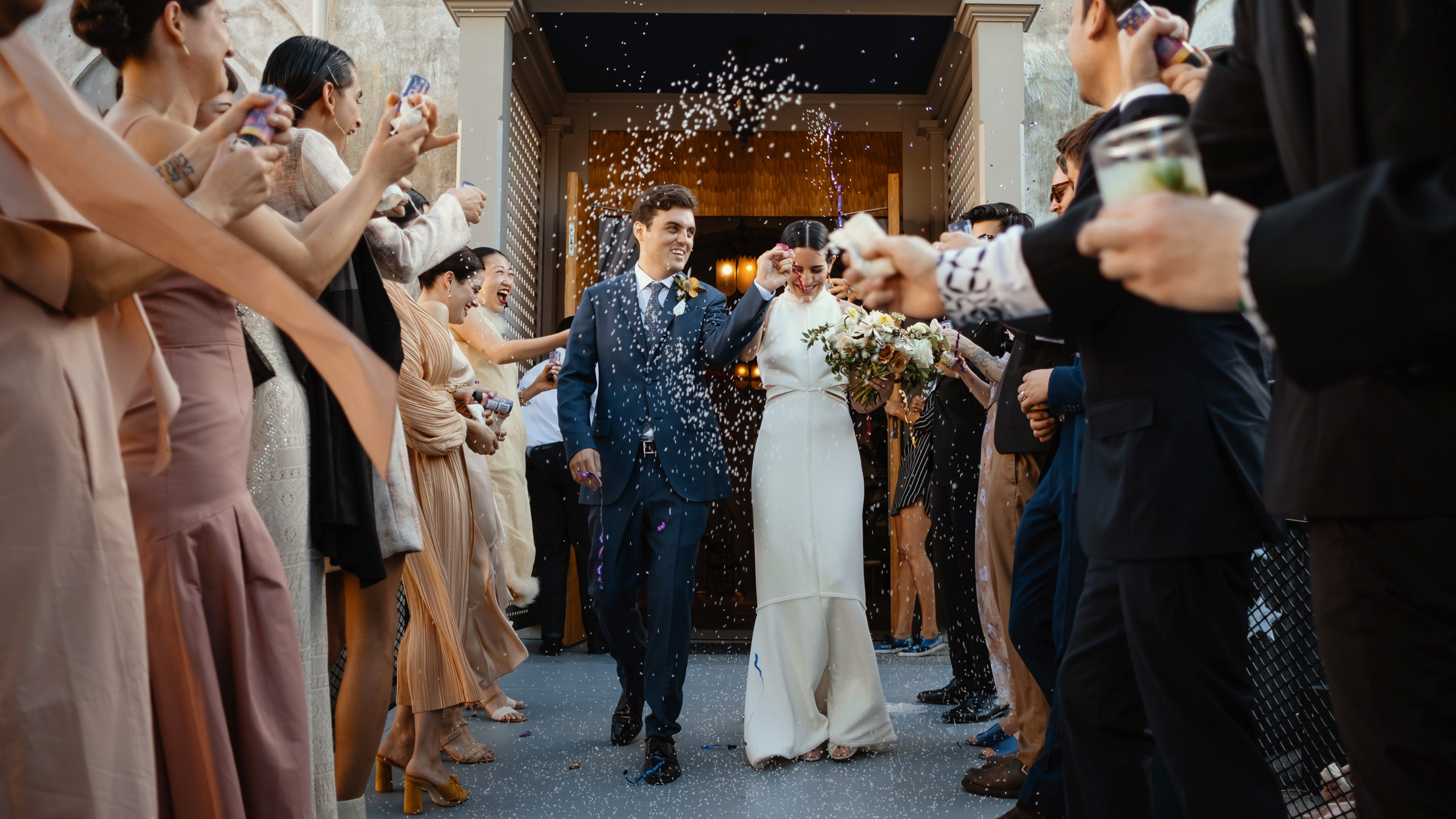 Couple recessional amid rice - photo by Dark Roux