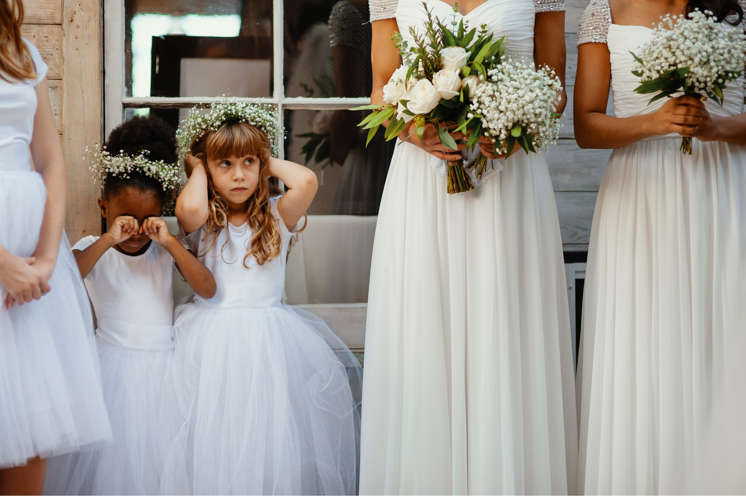 flower girls being funny during ceremony-new orleans-austin-houston- photo by Dark Roux