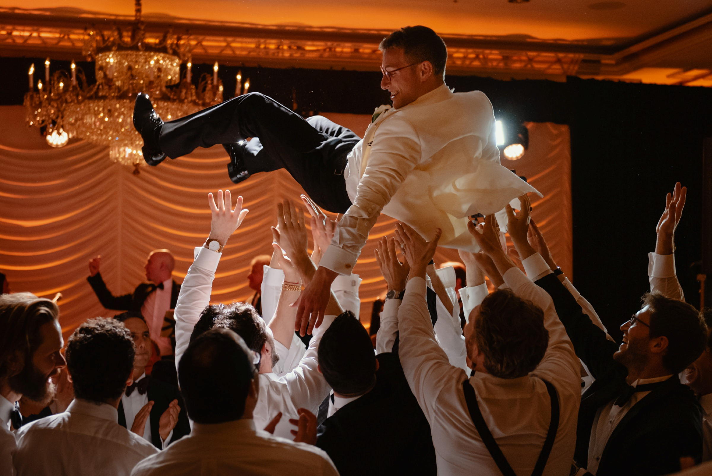groom being held up in the air by all the groomsmen at the reception-new orleans-austin-houston-wedding- photo by Dark Roux