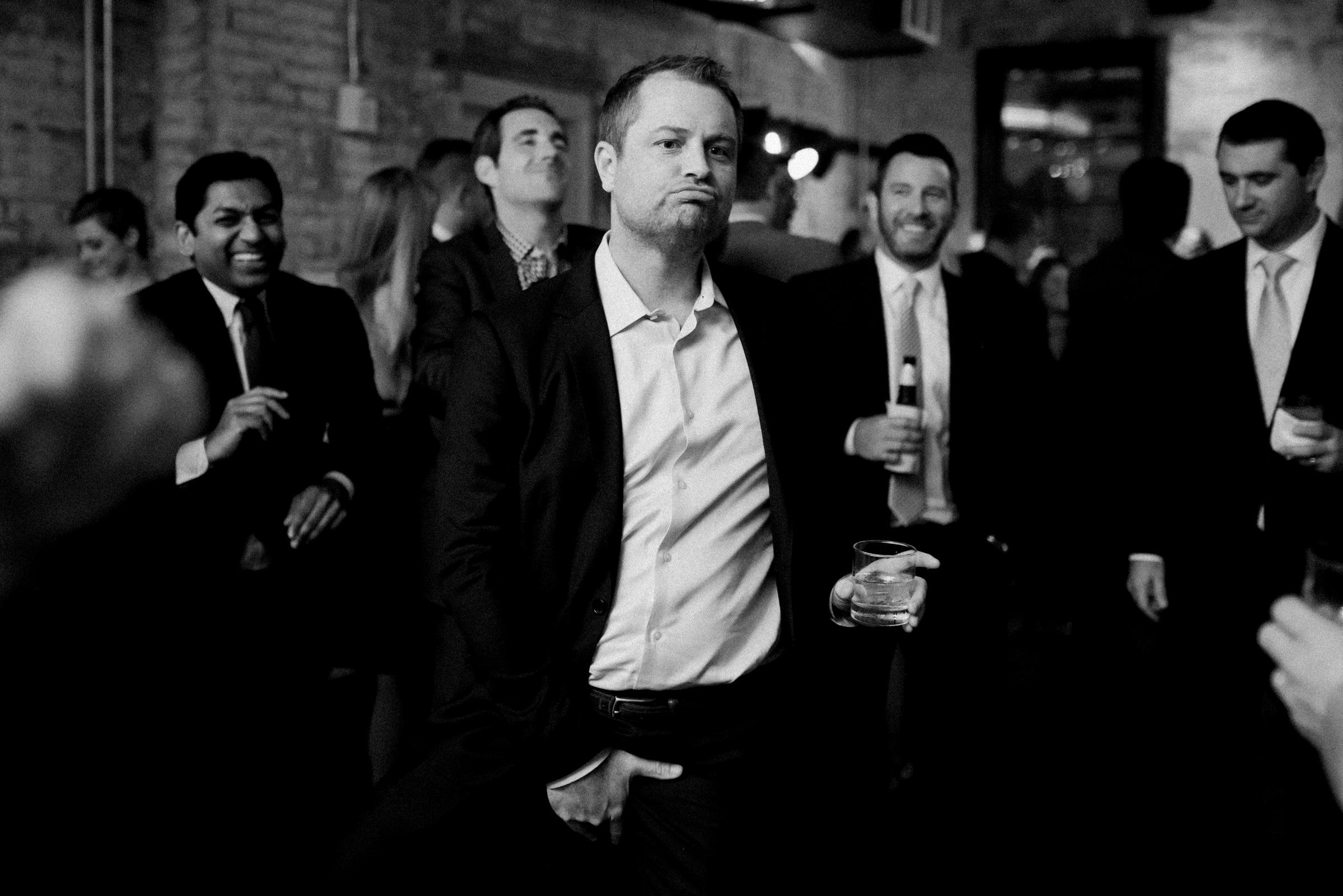 groom dancing the night away at the reception with his groomsmen-new orleans-austin-houston-wedding photogra- photo by Dark Roux