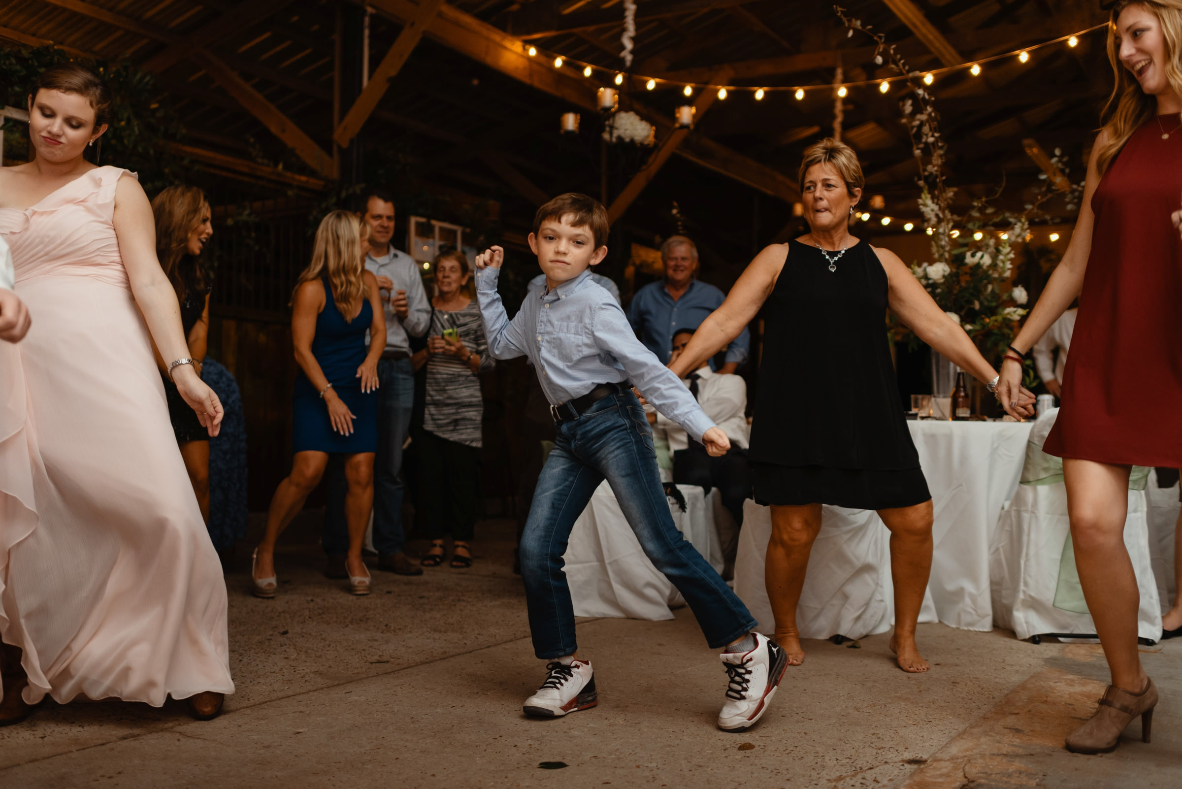 little boy dancing on the dance floor-new orleans-austin-houston-wedding photographer- photo by Dark Roux
