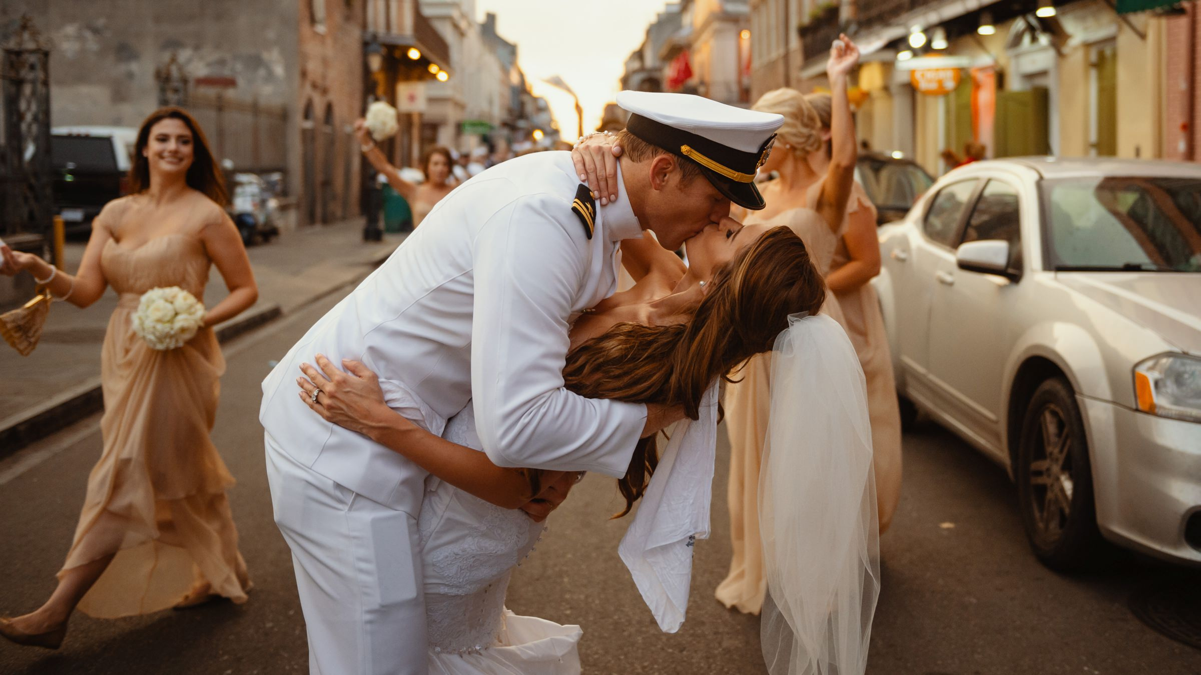 military groom kissing his bride-new orleans-austin-houston-wedding- photo by Dark Roux
