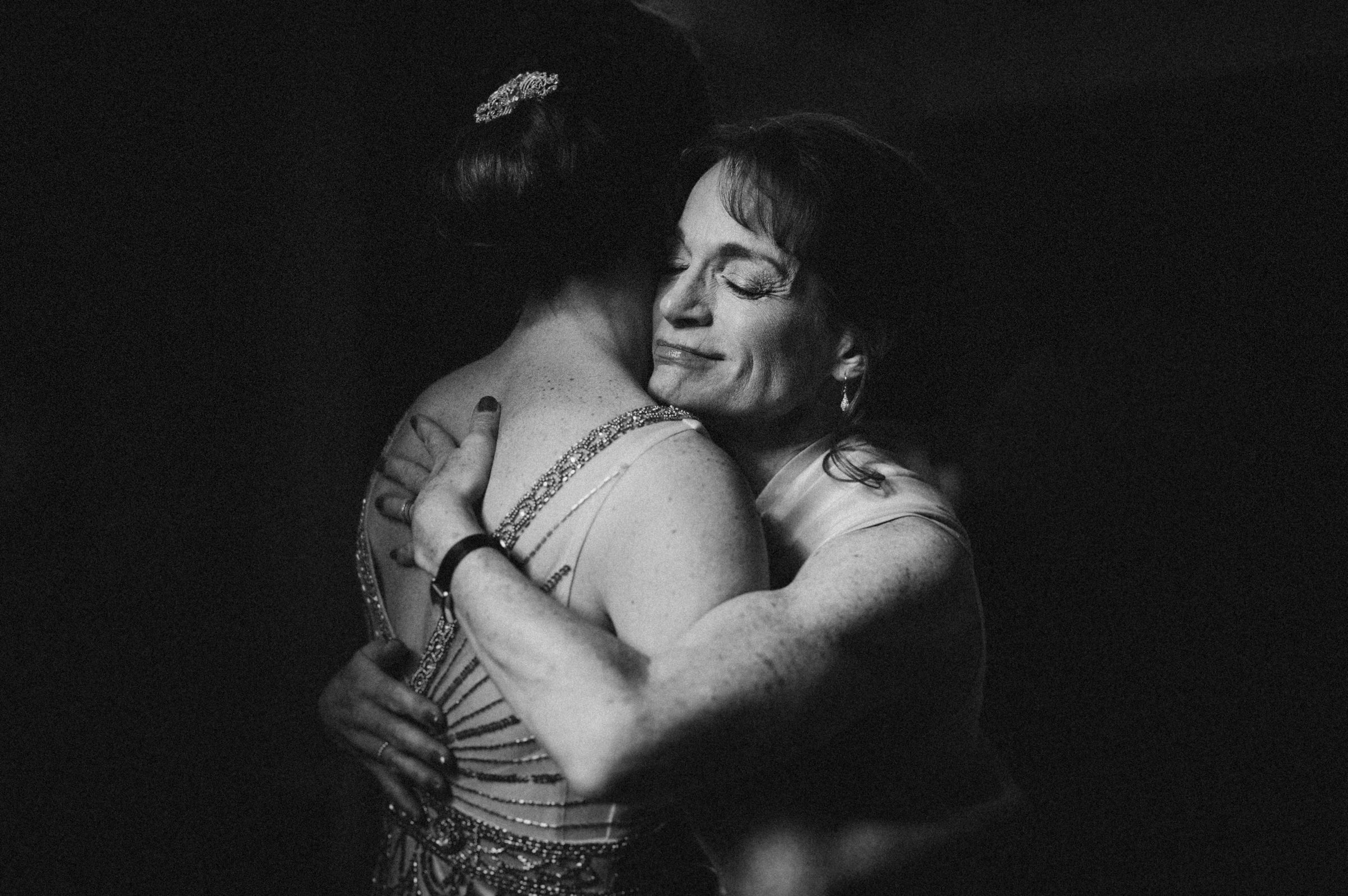 mom hugging her daughter sweetly-new orleans-austin-houston-wedding- photo by Dark Roux