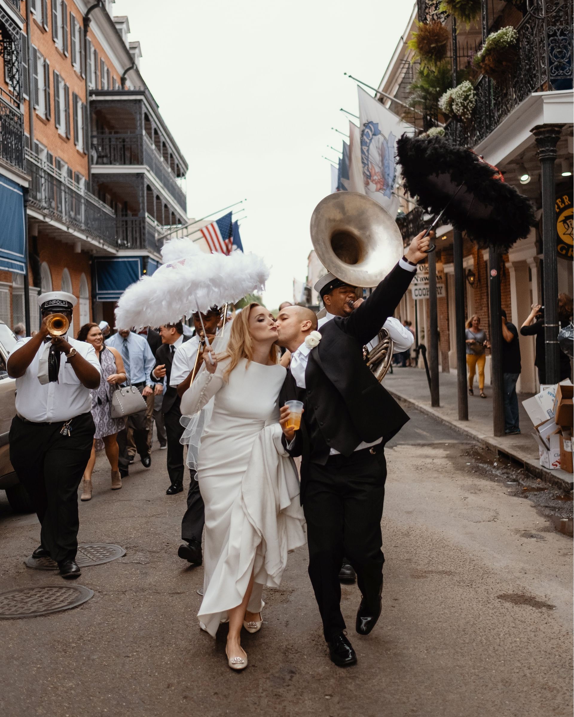 New Orleans parade with just married couple - photo by Dark Roux