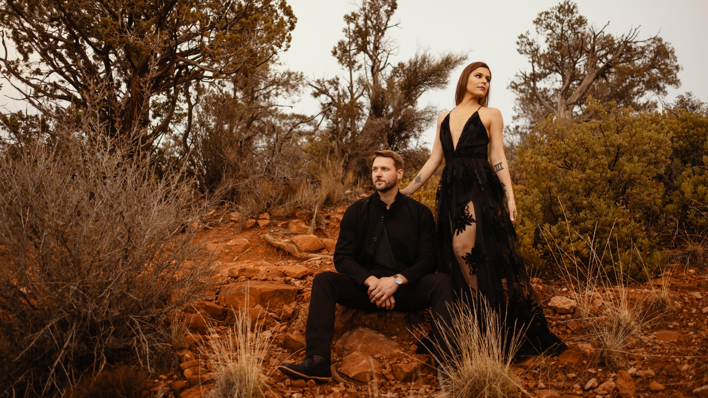 Engagement photo of couple with woman wearing black dress by Dark Roux, Austin, Texas