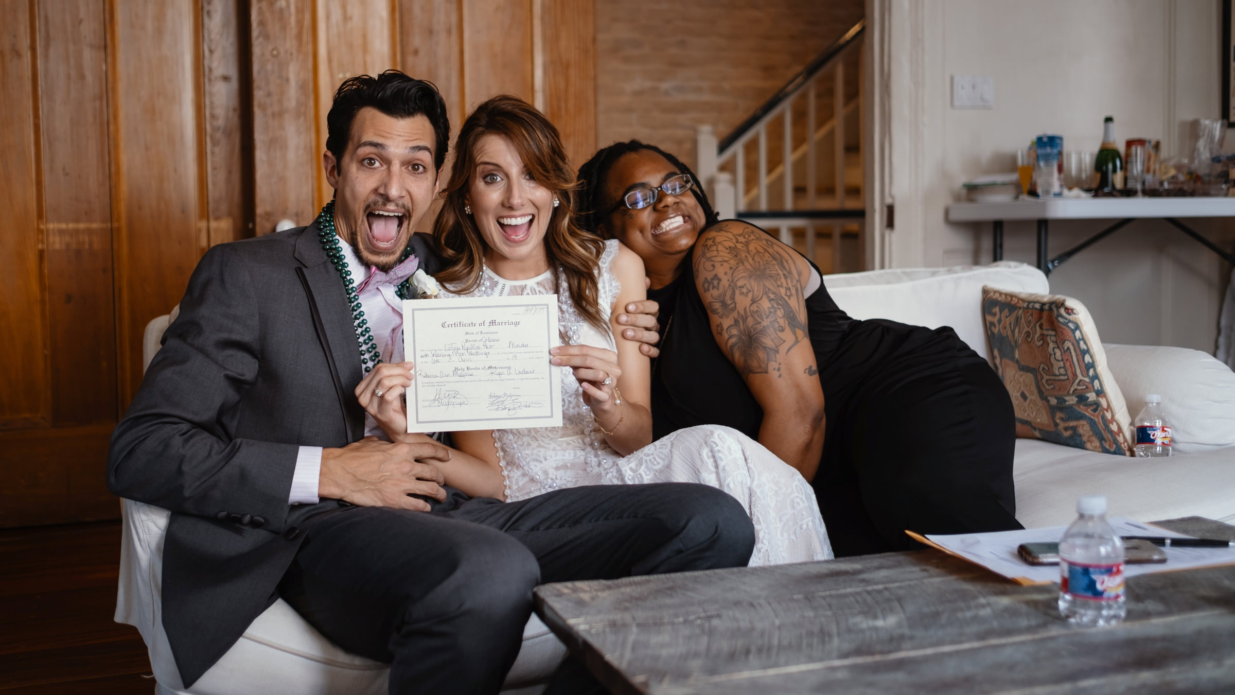 Photo of couple holding up marriage certificate by Dark Roux, Austin, Texas