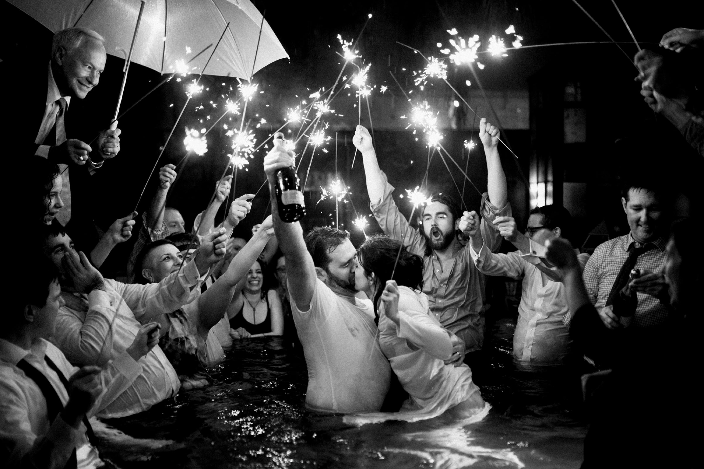 Photo of couple in just married couple in hottub with sparklers by Dark Roux, Austin, Texas