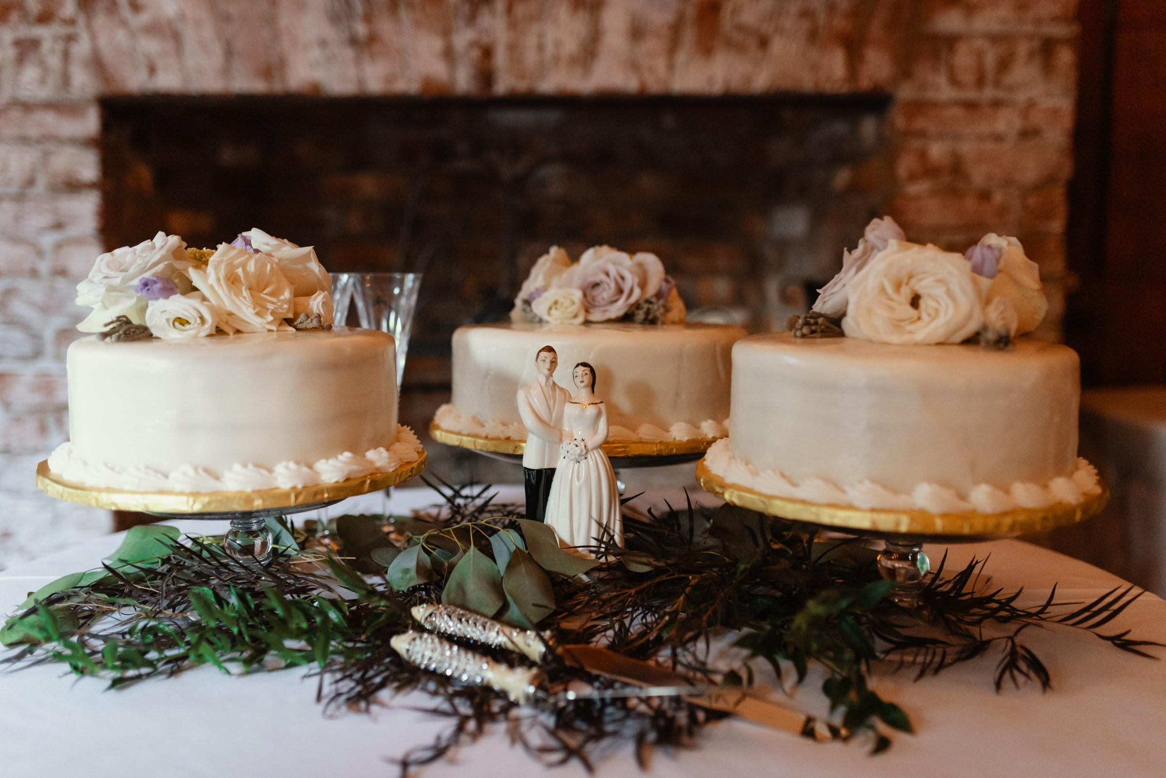 three wedding cakes with bride and groom statuette - photo by Dark Roux