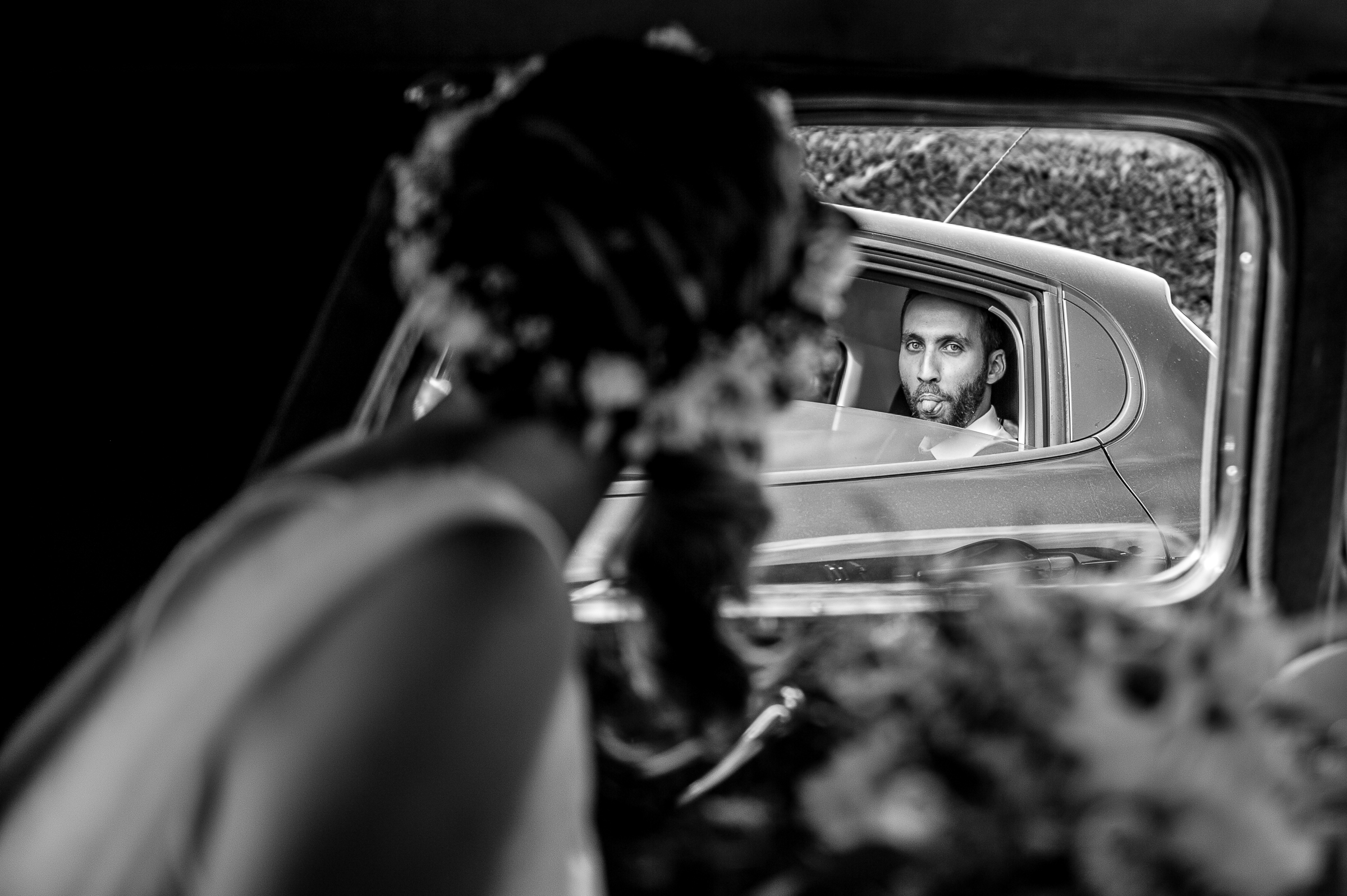 Bride and groom in passing limos - photo by Gaelle Le Berre Photography