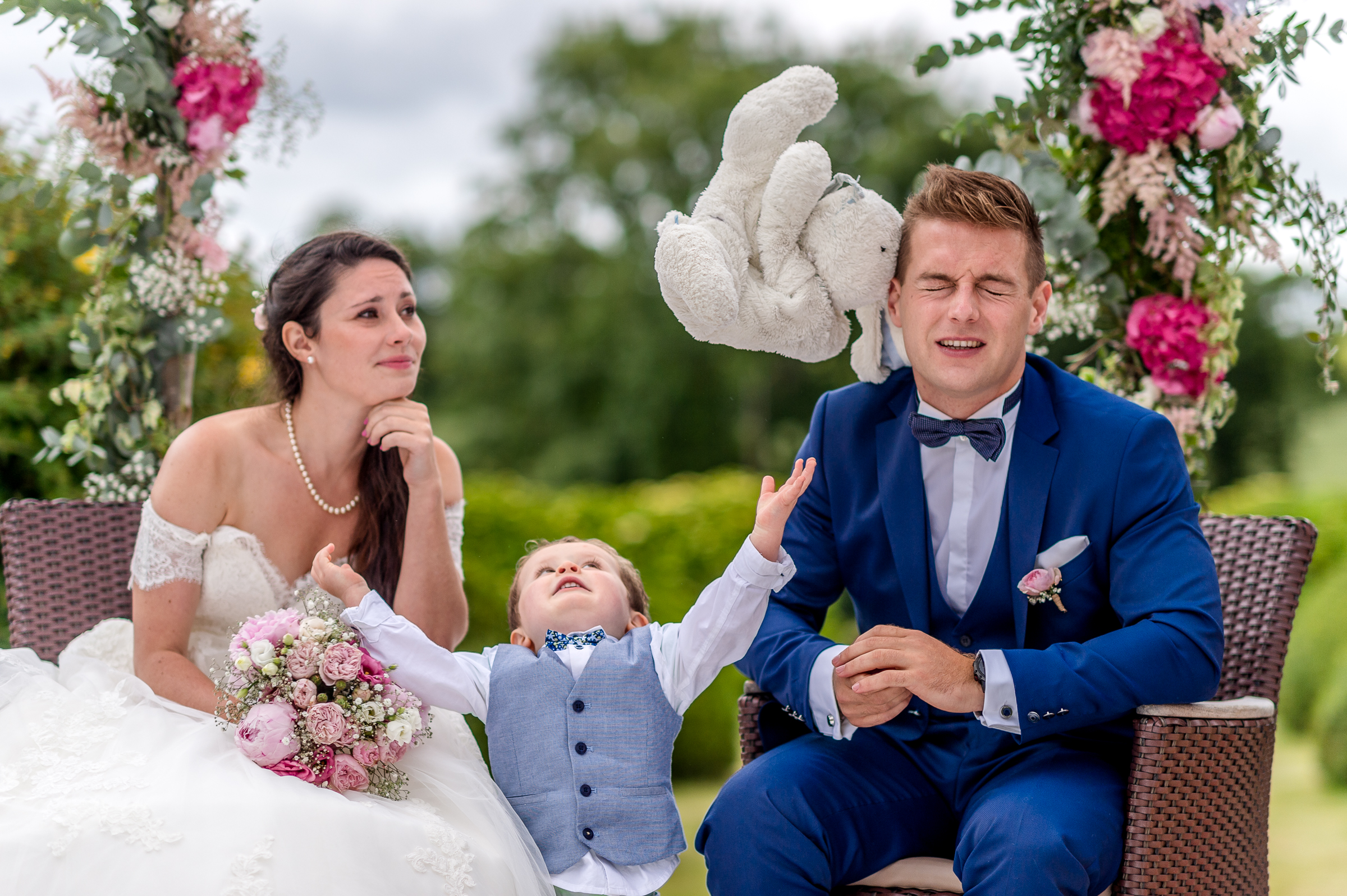 Couple with little boy and airborne stuffed bunny - photo by Gaelle Le Berre Photography