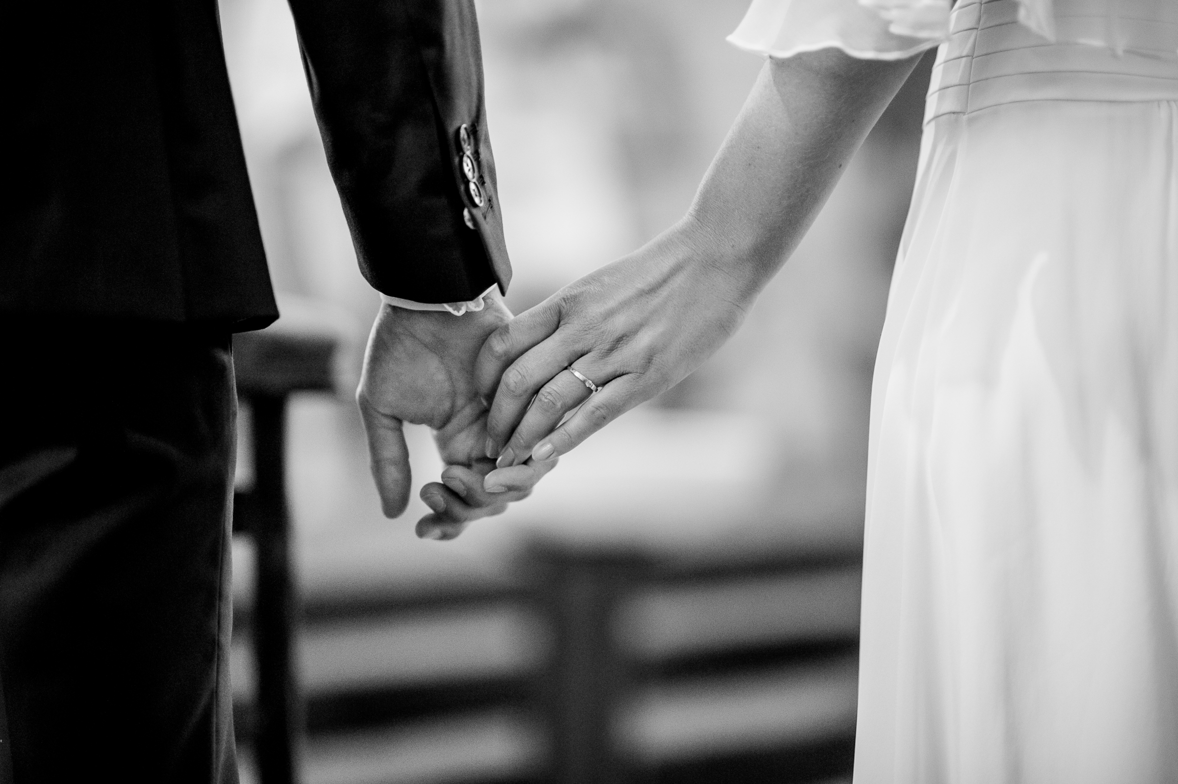 Detail of couple holding hands - photo by Gaelle Le Berre Photography