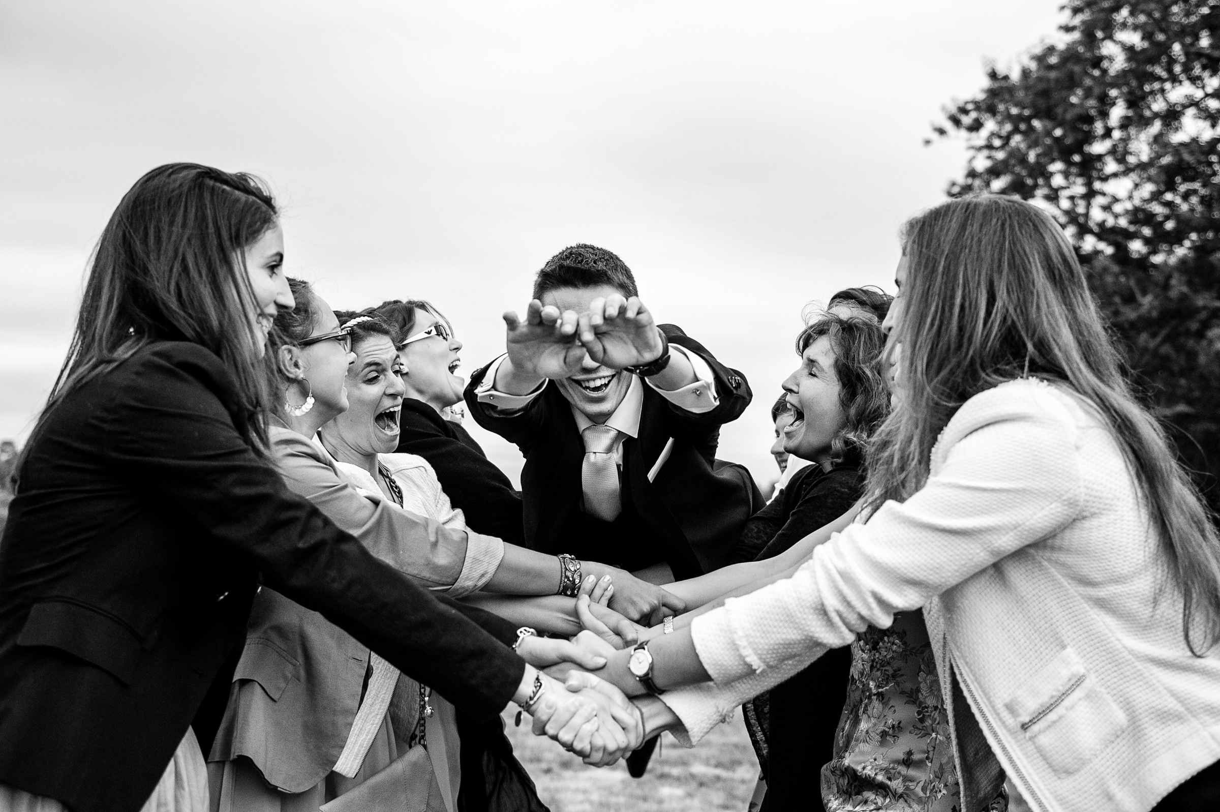 groom diving onto outstretched arms - photo by Gaelle Le Berre Photography