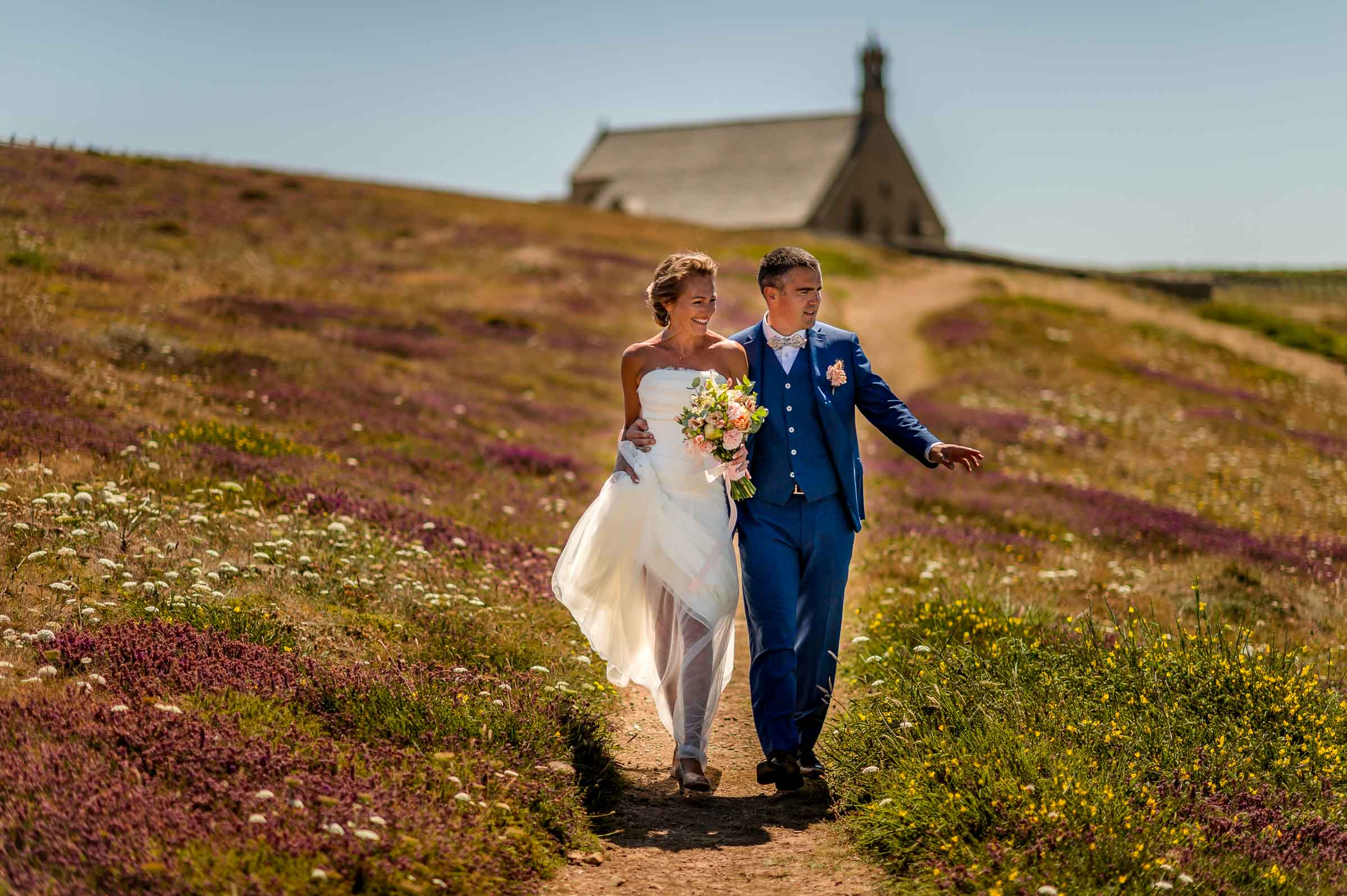 Couple on path from country church - photo by Gaelle Le Berre Photography