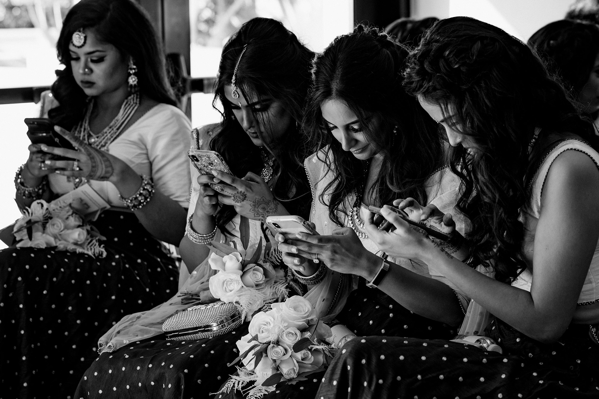 Bridal party with their phones - photo by Matei Horvath Photography