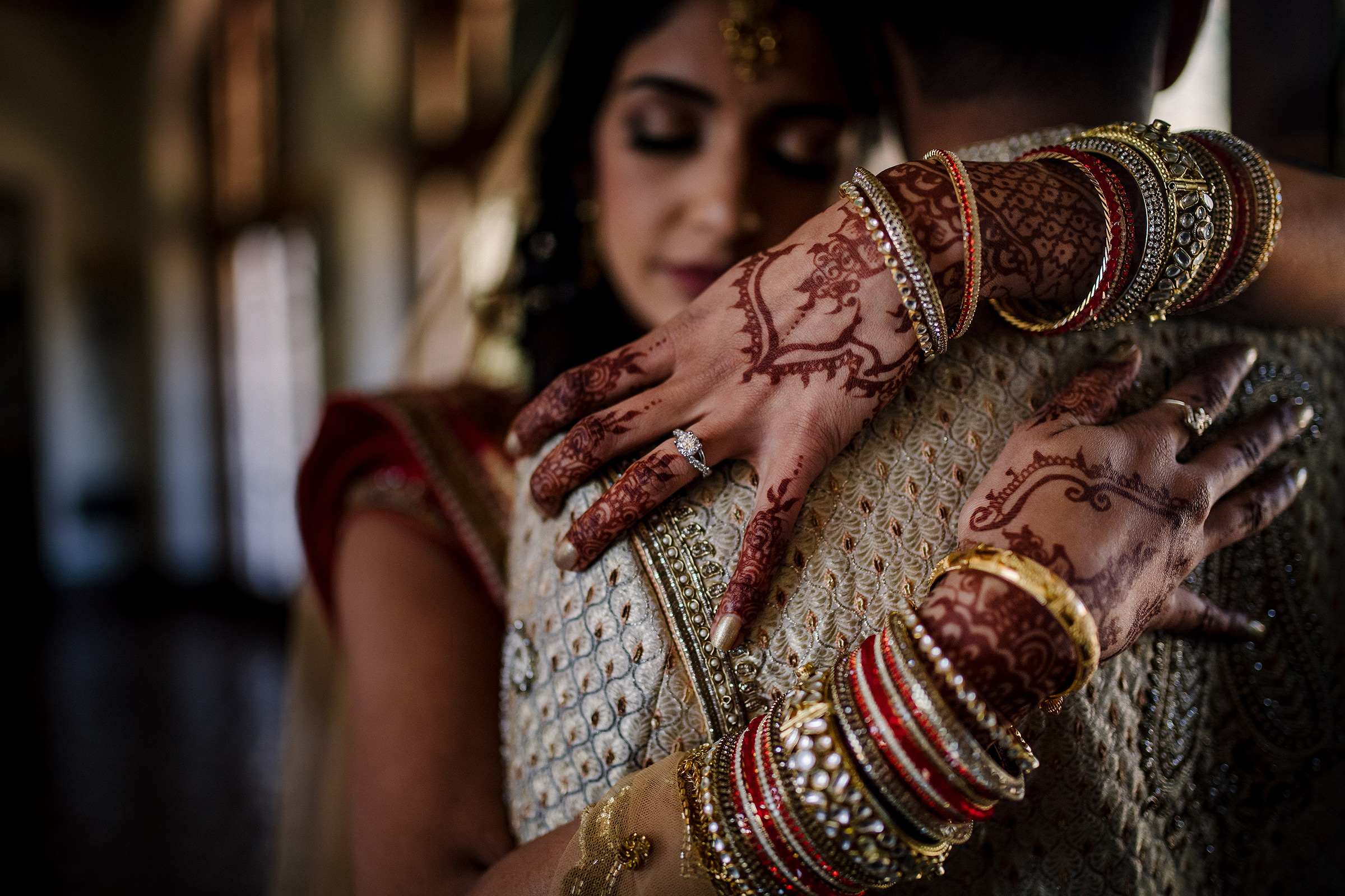 Bride with henna hands embracing groom - photo by Matei Horvath Photography