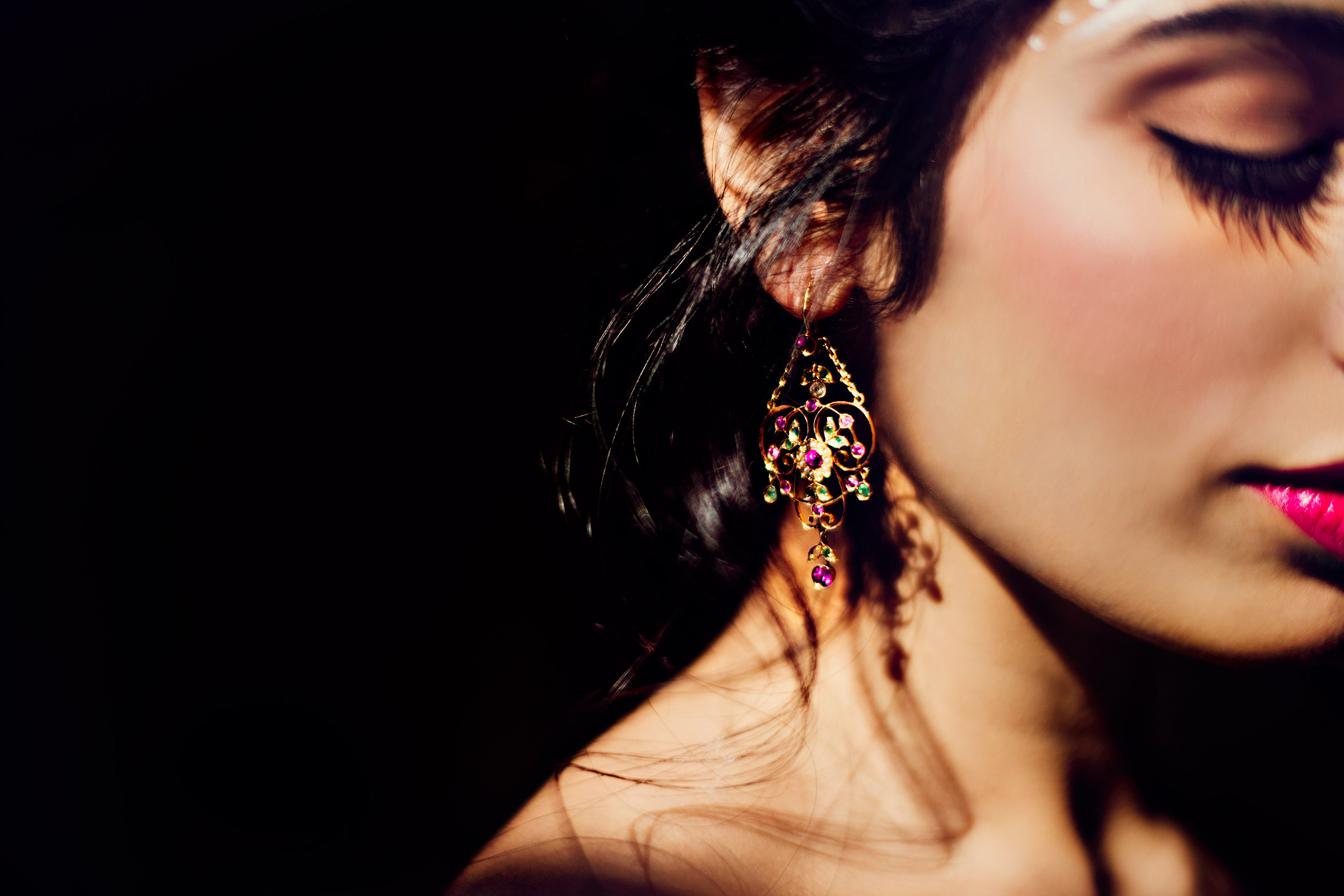Closeup of bride's face with earring and shadows - photo by Matei Horvath Photography