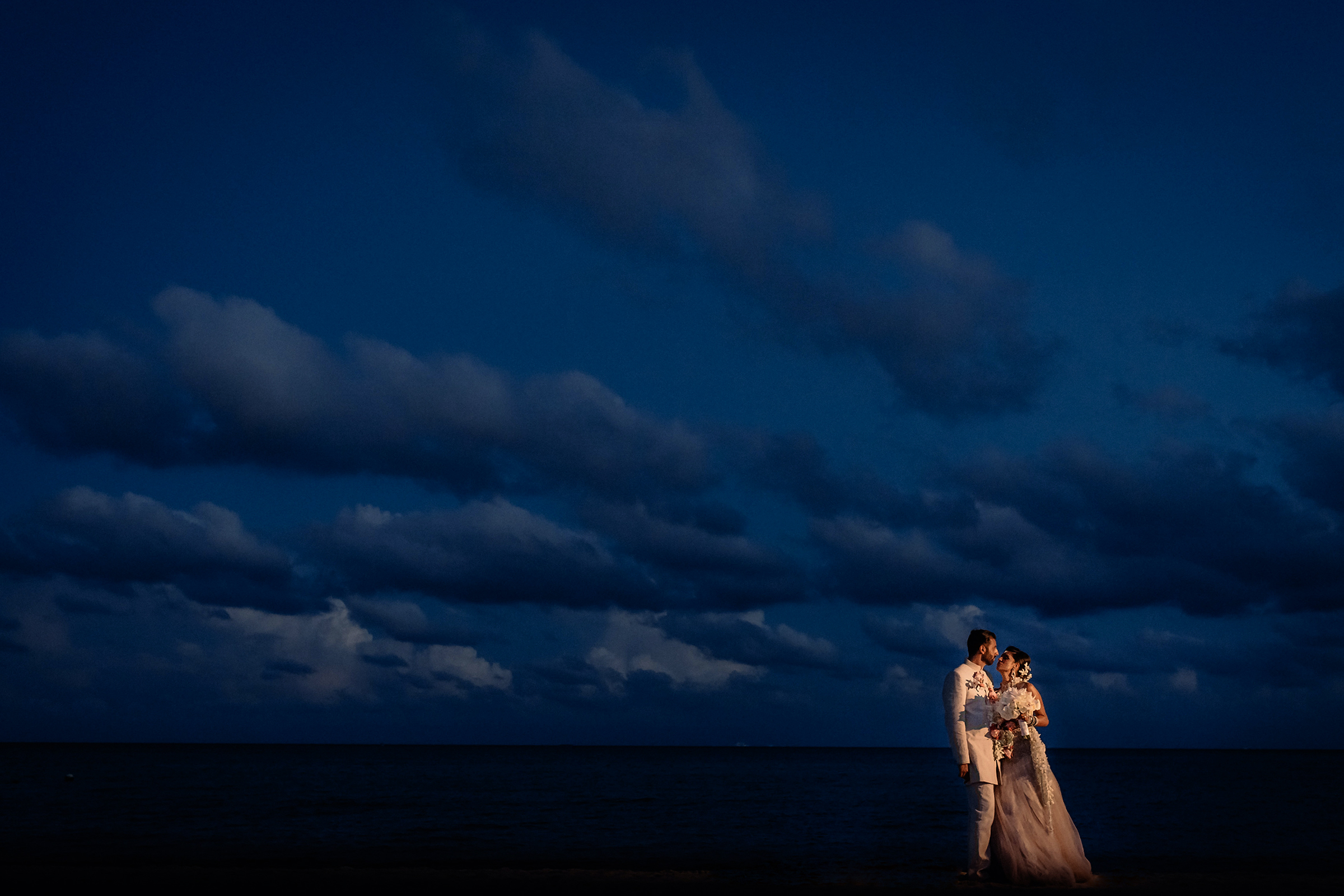 Indian couple against dramatic nighttime sky - photo by Matei Horvath Photography