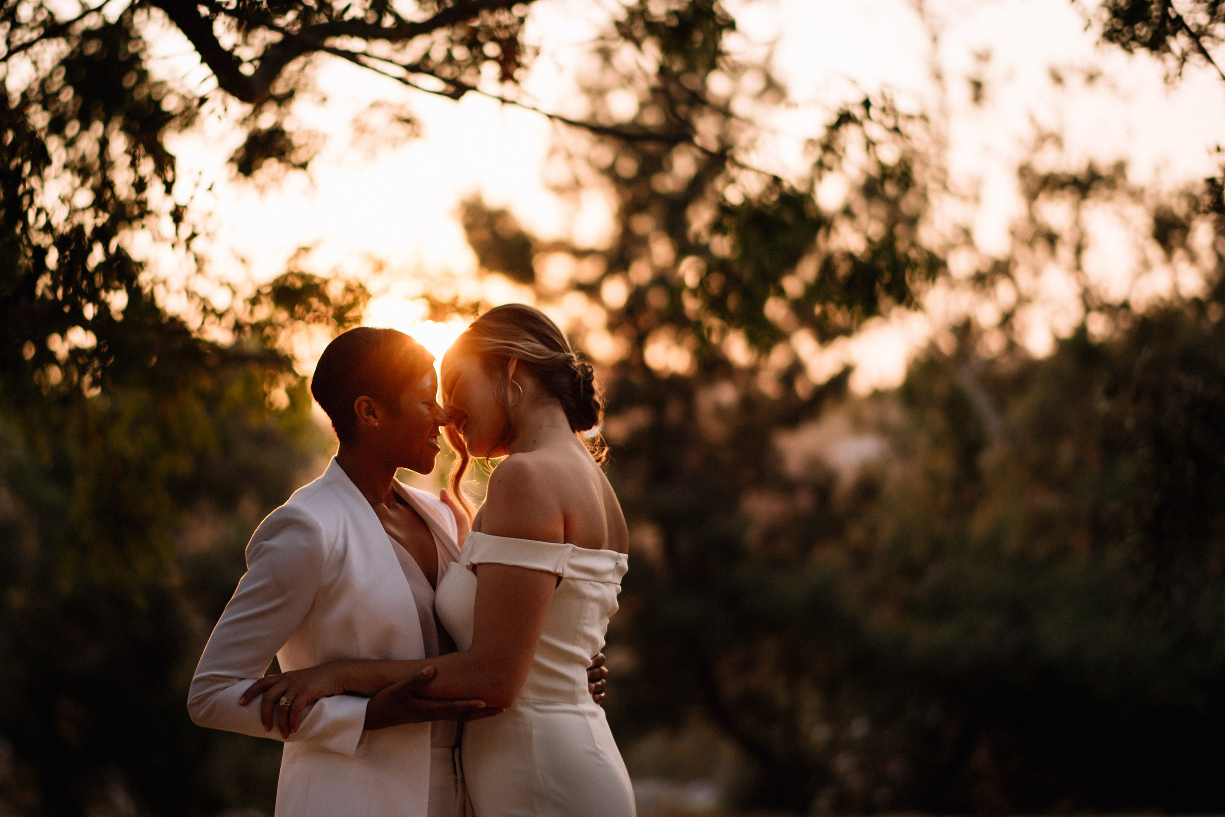 Lens flare intimate two bride moment - photo by Matei Horvath Photography
