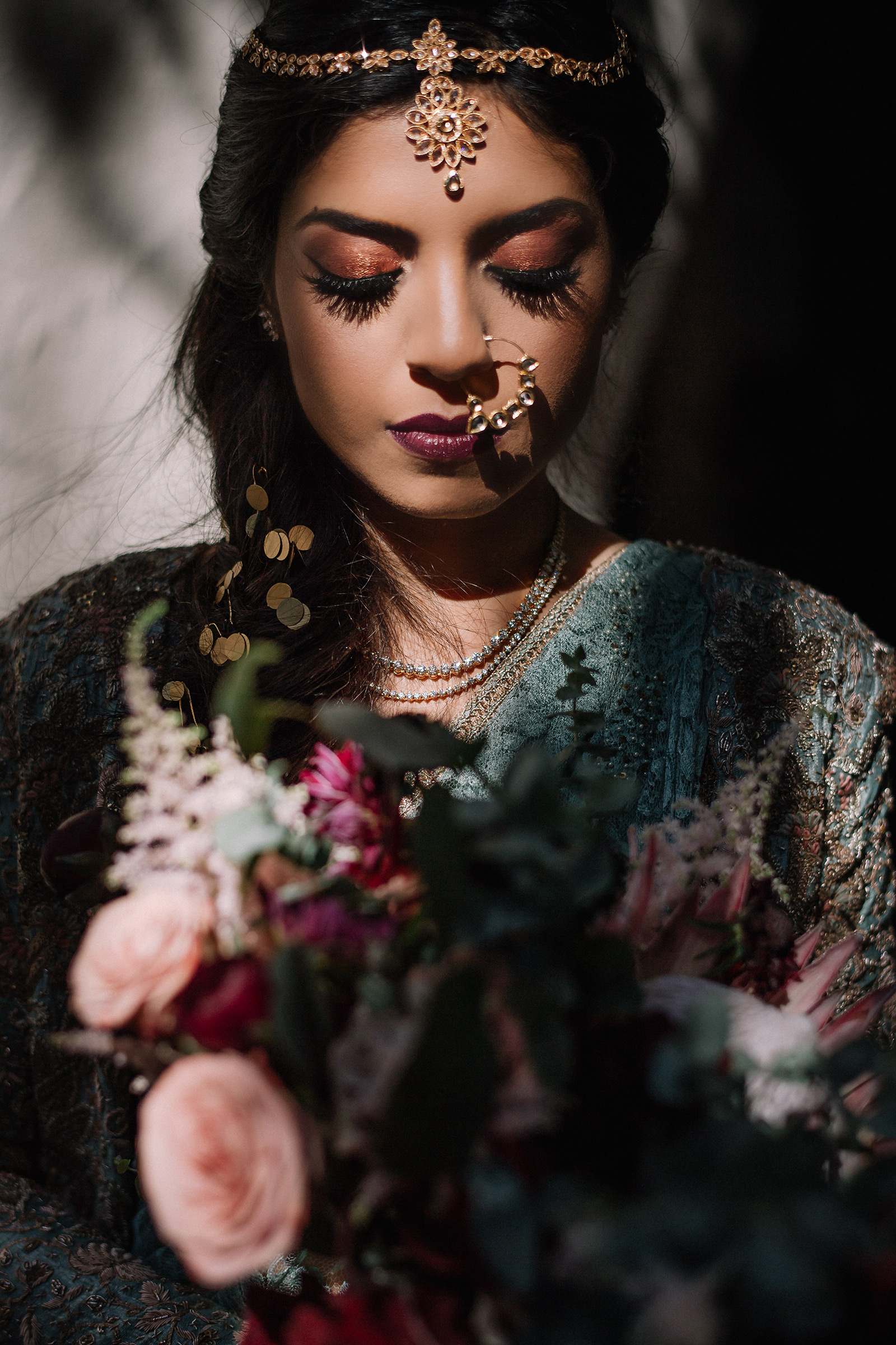 Stunning Indian bride portrait with downcast eyes and shadows - photo by Matei Horvath Photography