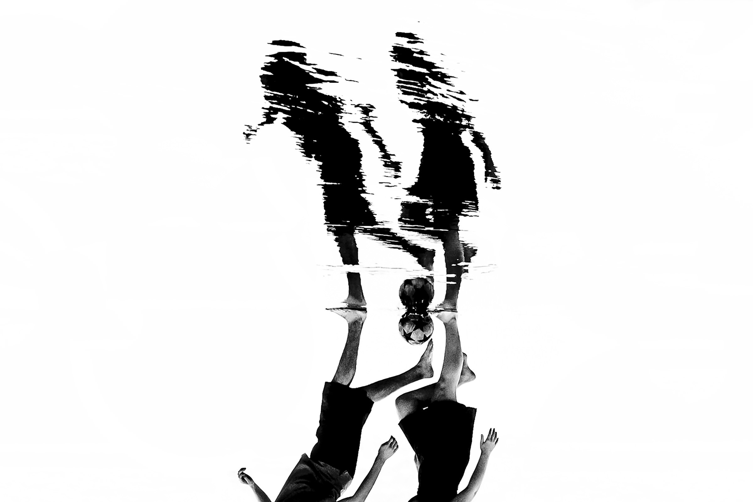 Couple walking with soccer ball and reflection - photo by Ian Chin Photography