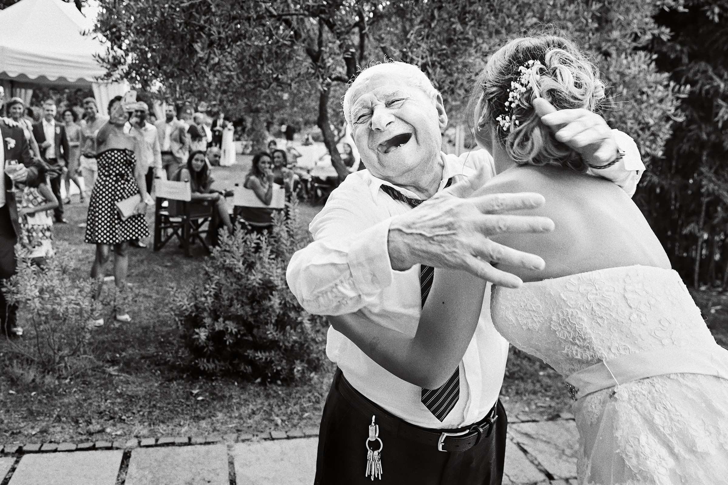 Bride embracing laughing grandfather - photo by Andrea Bagnasco Fotografie